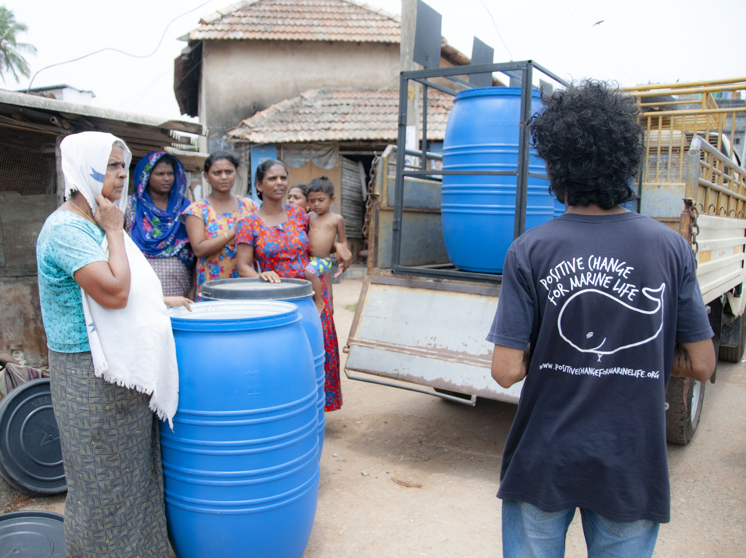Krishna delivering our new recycling bins to the community in Kottapuram.