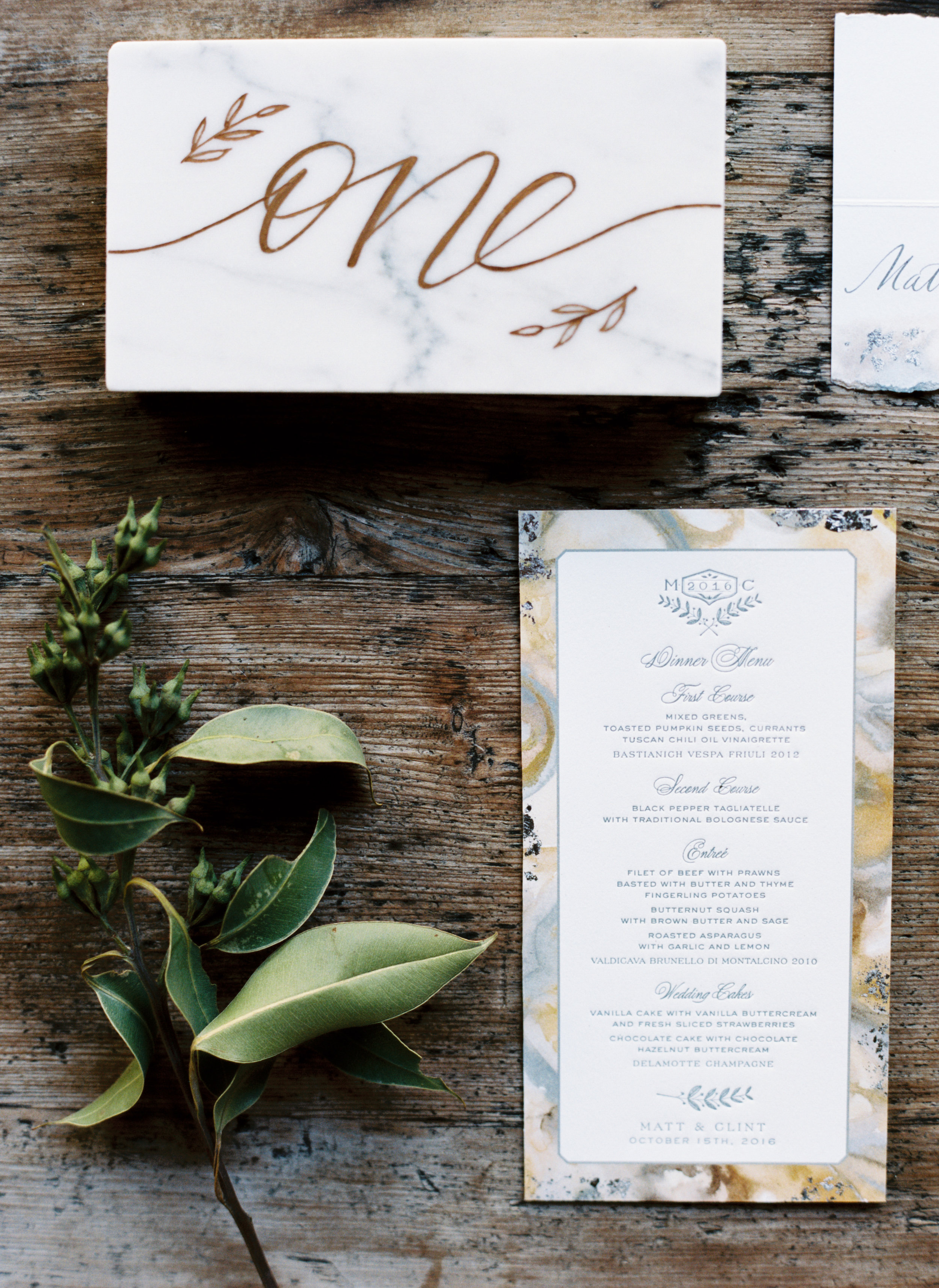 These letterpress menus were each adorned with silver leaf.