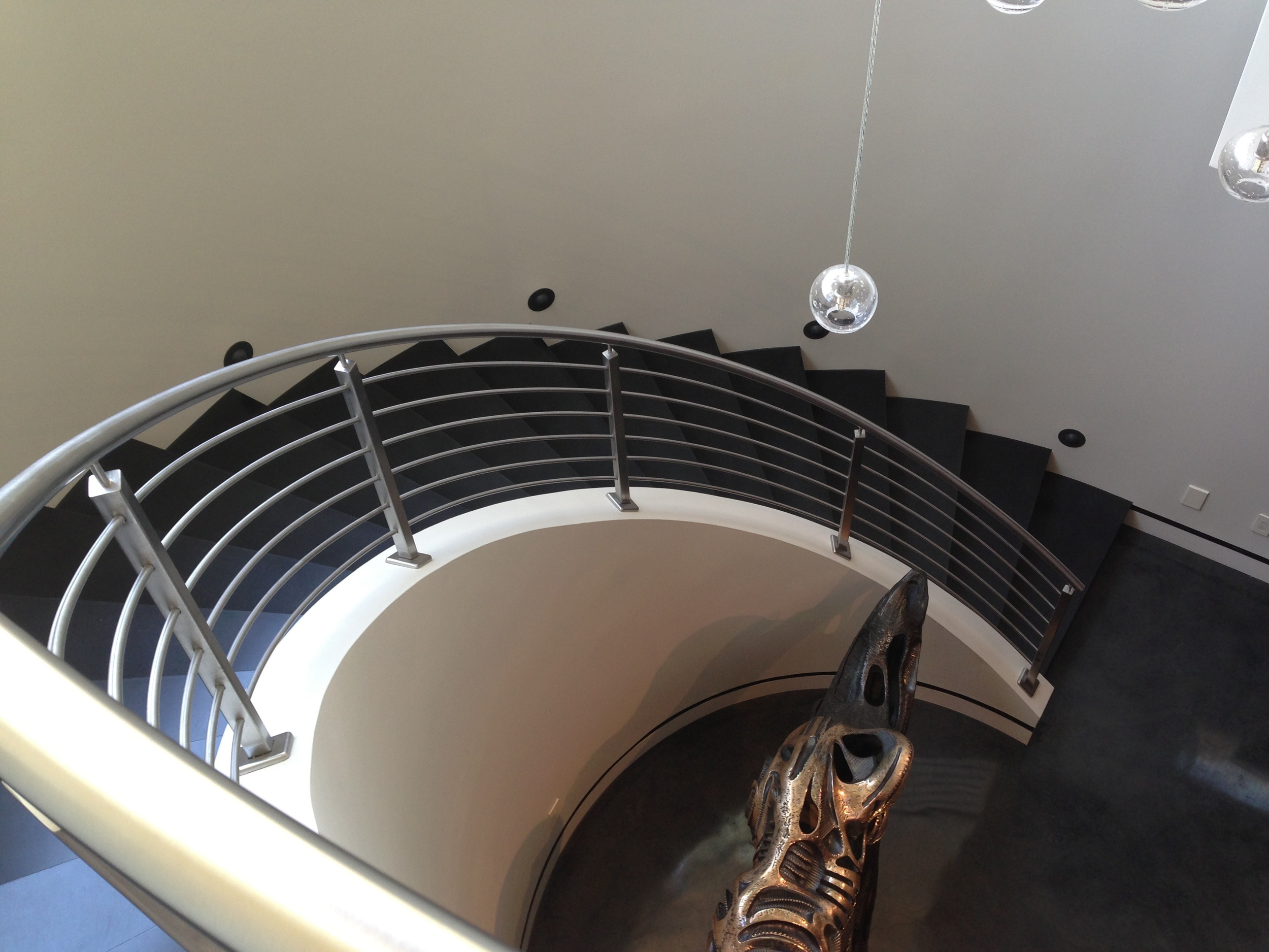 concrete stairs, custom, black stairs, spiral stair case, metal hand rail