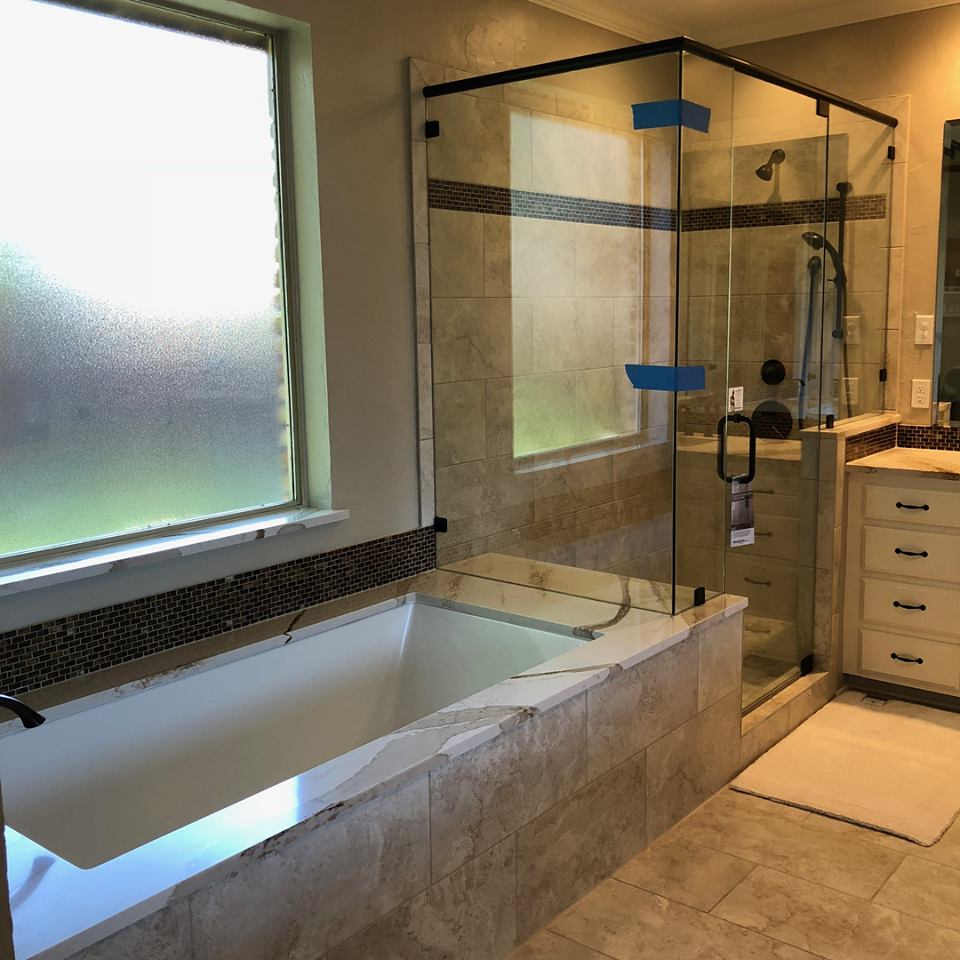 - Cambria extended into shower structure for a functional seat.
