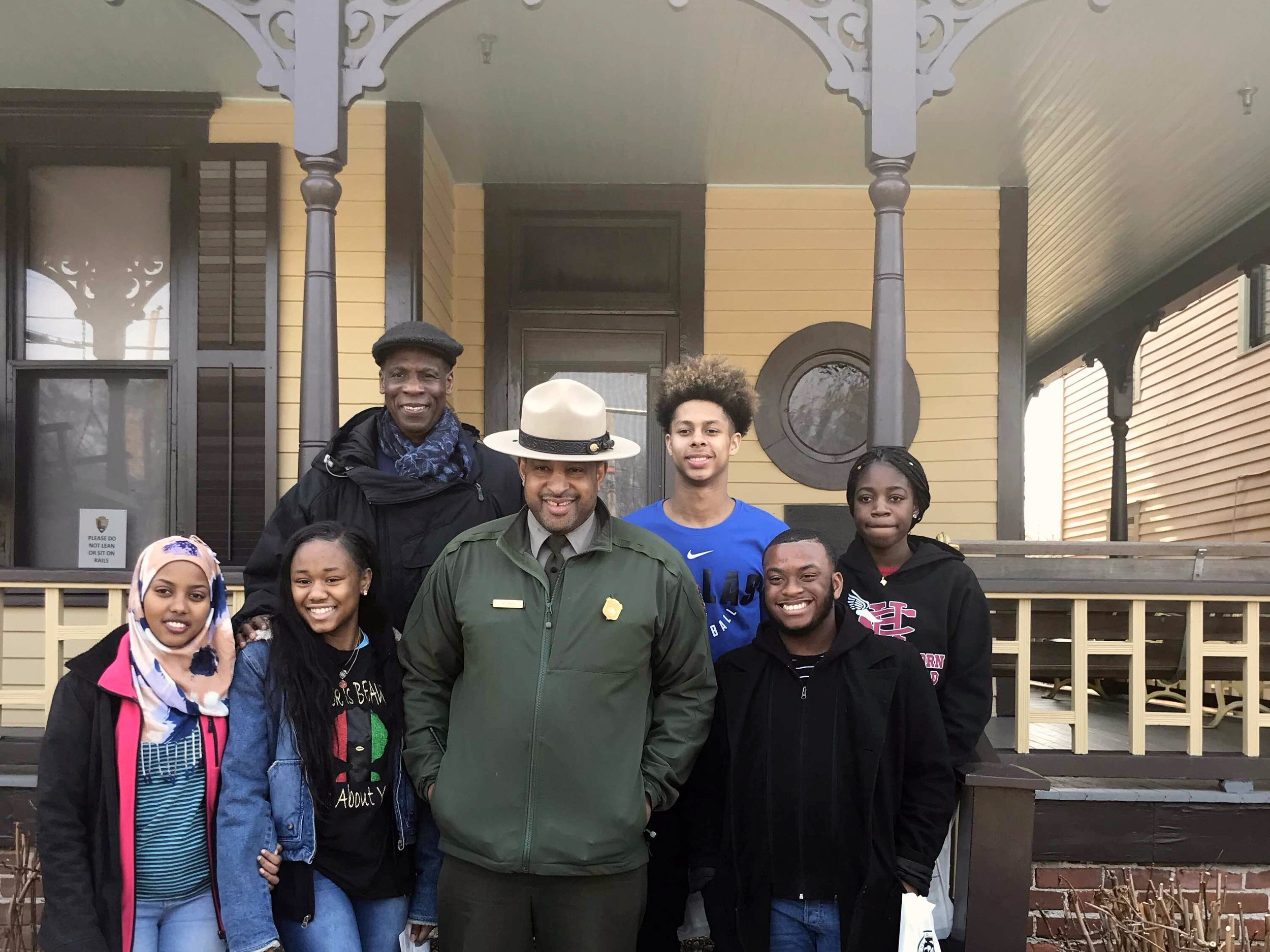 The group of contest winners and their guide in front of MLK's home.