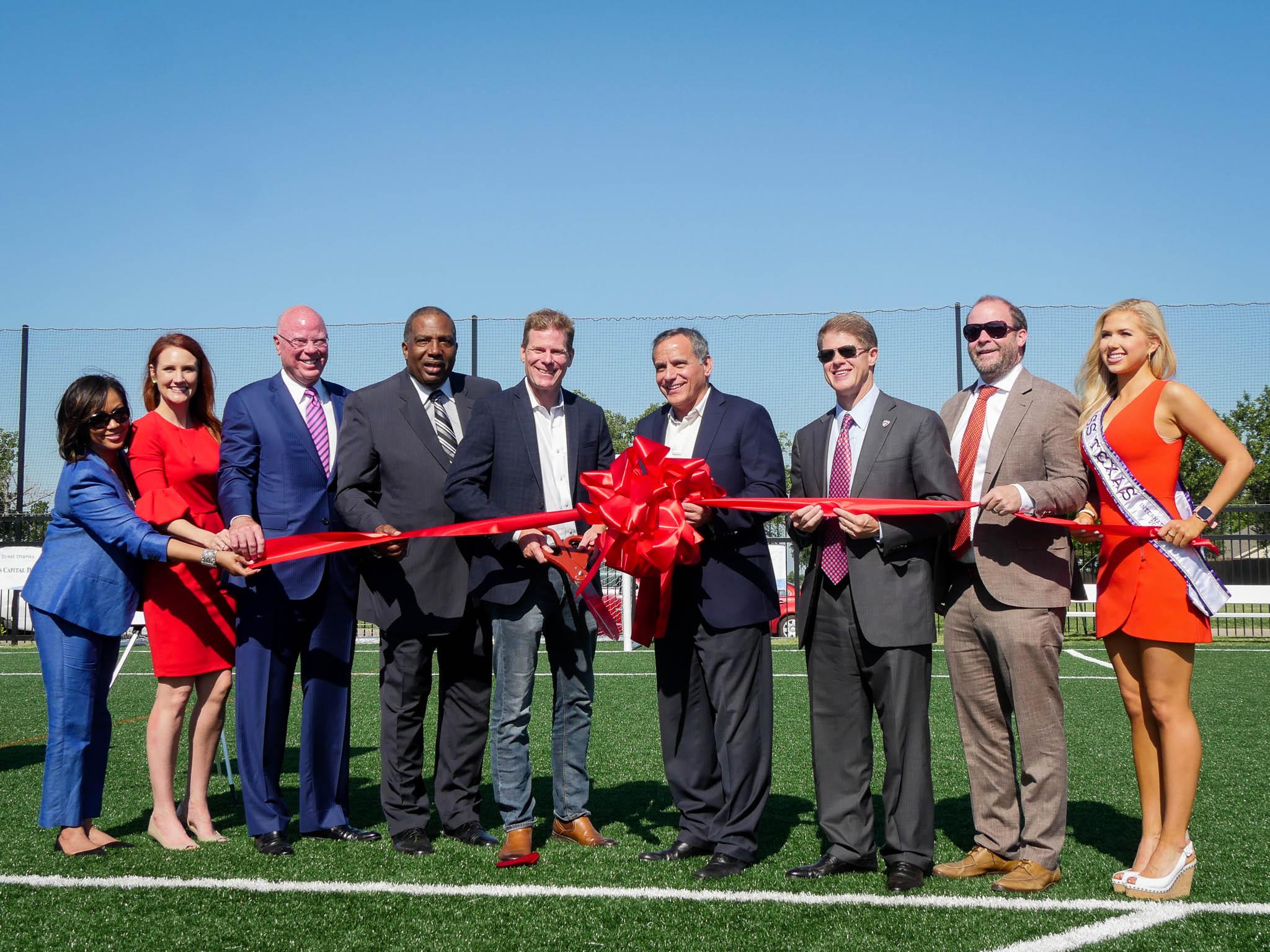 From left to right: Effie Dennison (TCB), Jamie Byum (ETP), Keith Cargill (TCB), Senator Royce West, Trey Hill (Mercy Street), Chris Curia (ETP), Clark Hunt (FC Dallas), Dan Hunt, Gracie Hunt