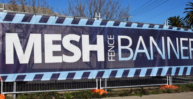 Mesh Banners are digitally printed in full color. Mesh is an outdoor banner material that is used in high wind locations instead of wind slits. Great for fence applications!
