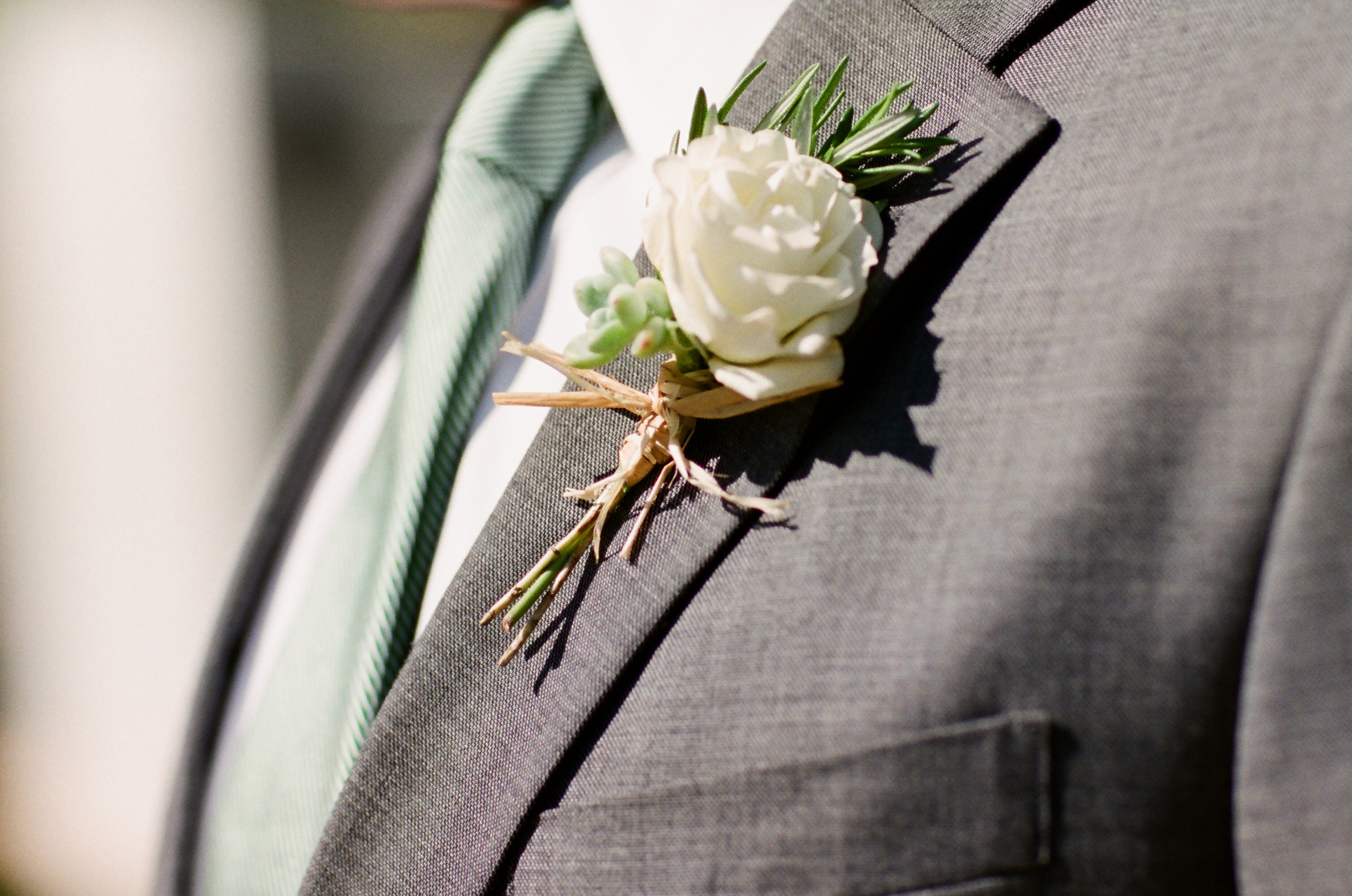 Rose and Succulent Boutonniere - Hoste Events