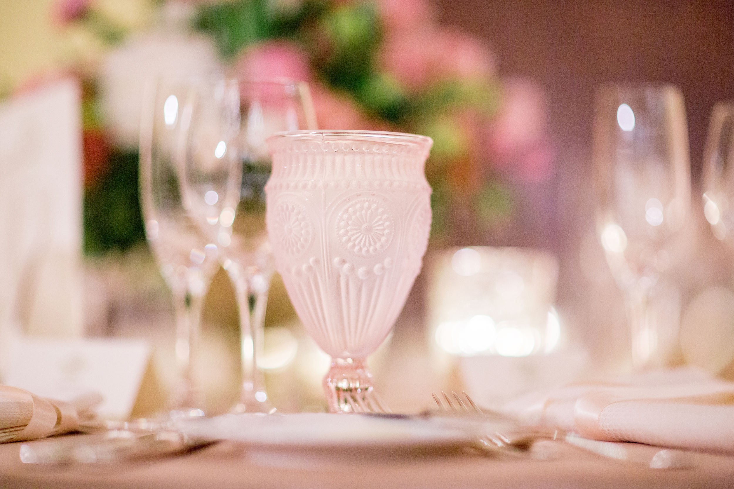 This pretty little pink vintage glass was the perfect touch to this blush wedding. Adding a special water glass is a great way to elevate the table without breaking the budget.  Glassware:Otis & Pearl Vintage Rentals - www.otisandpearl.com   Photo: Anna Costa - www.michaelandannacosta.com