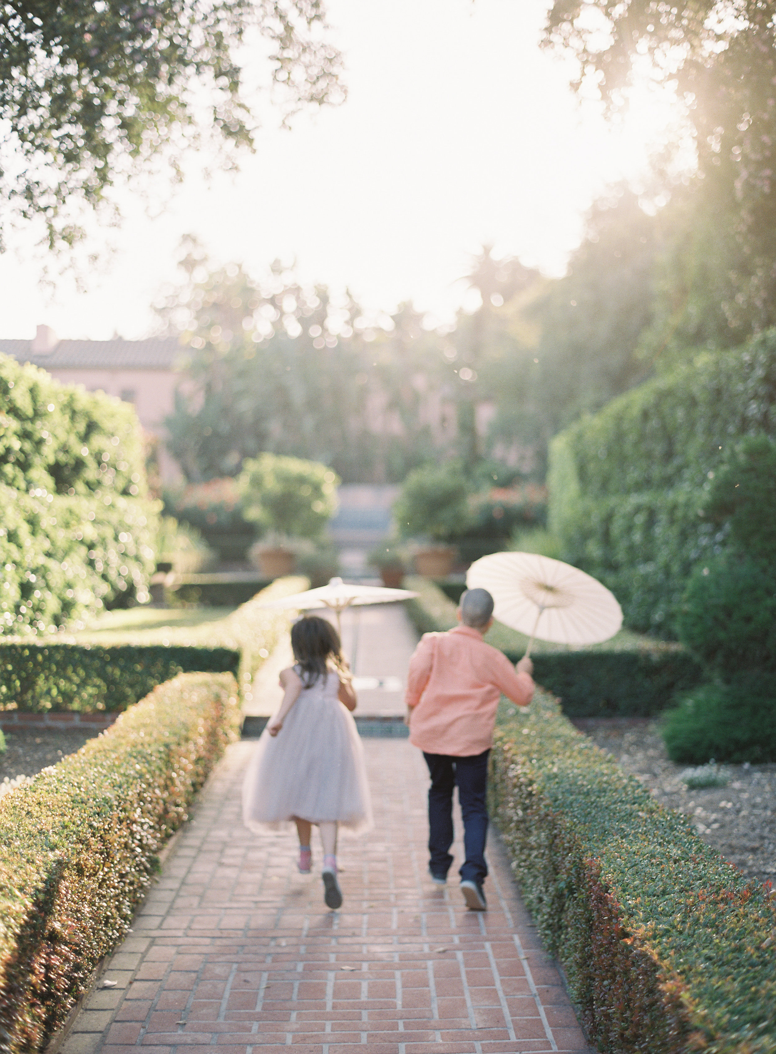 young wedding guests with paper umbrellas