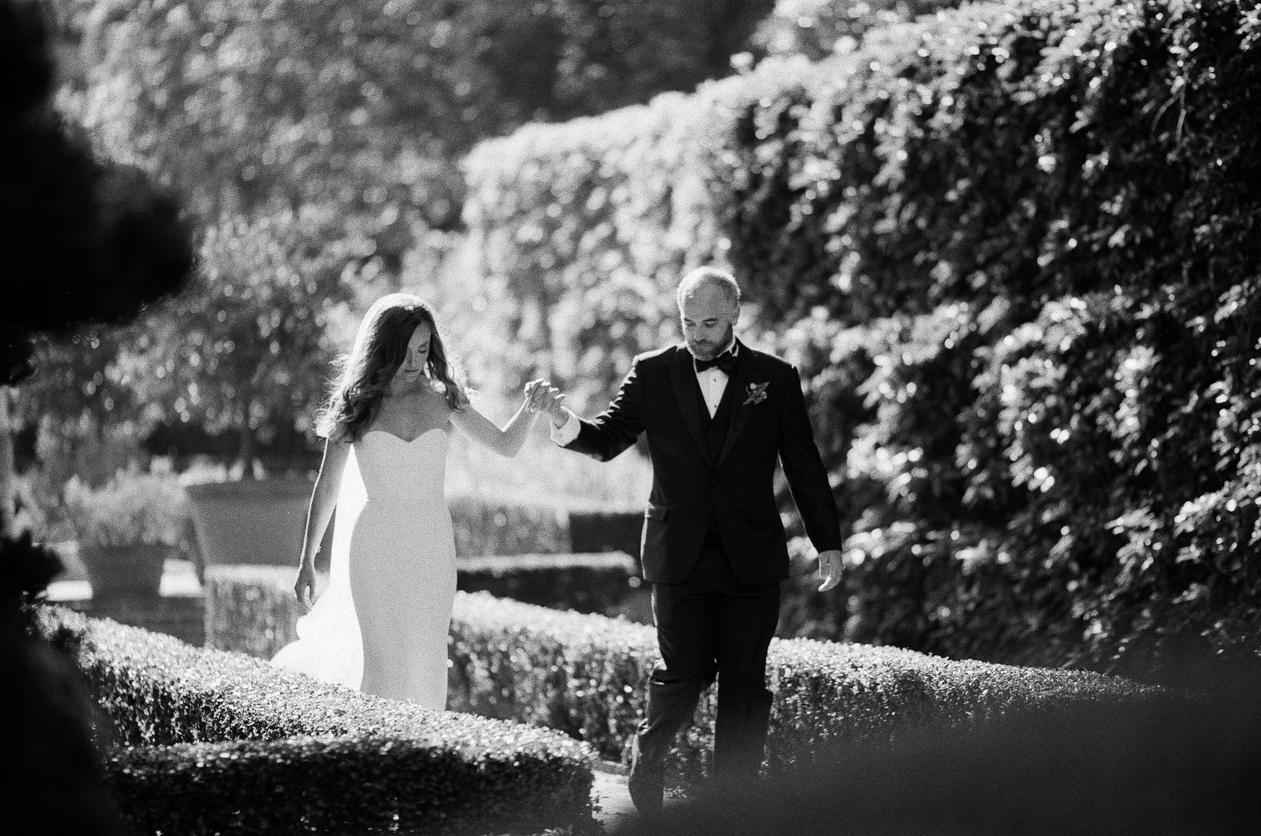 bride and groom entering garden reception