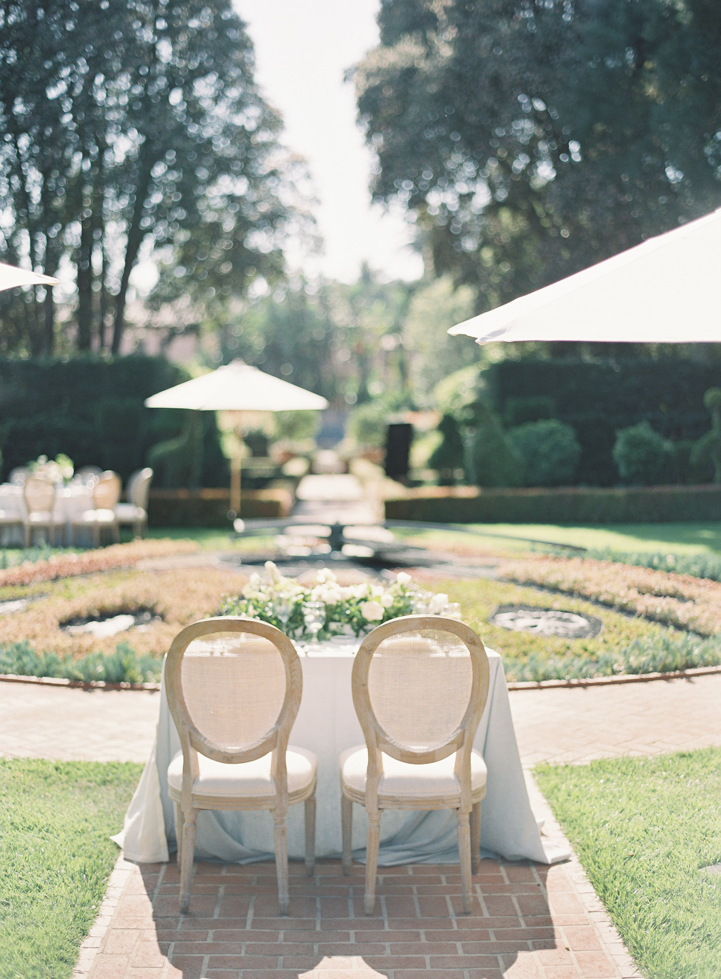 sweetheart table with white garden roses and greenery