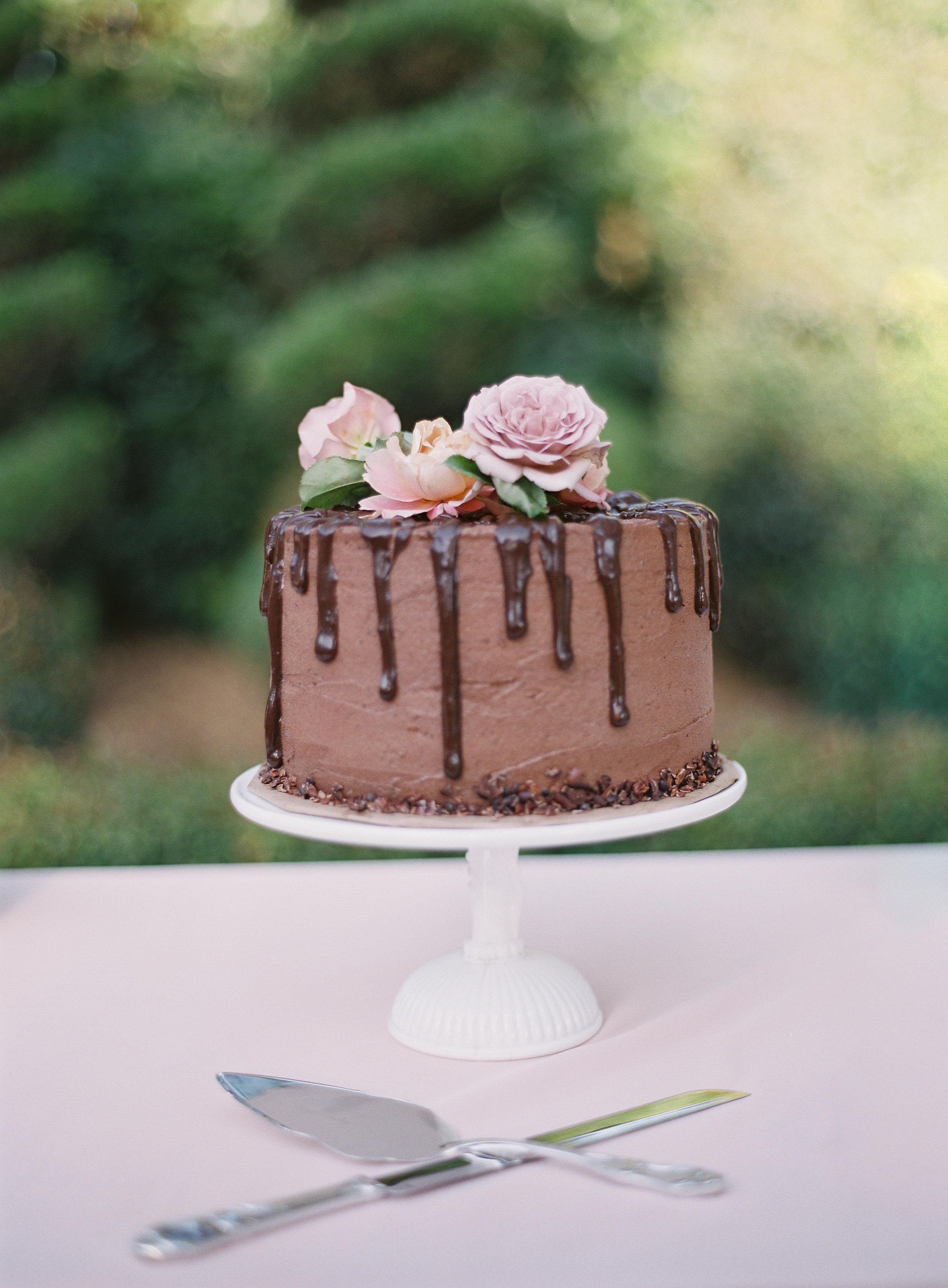 chocolate cutting cake with fresh flowers