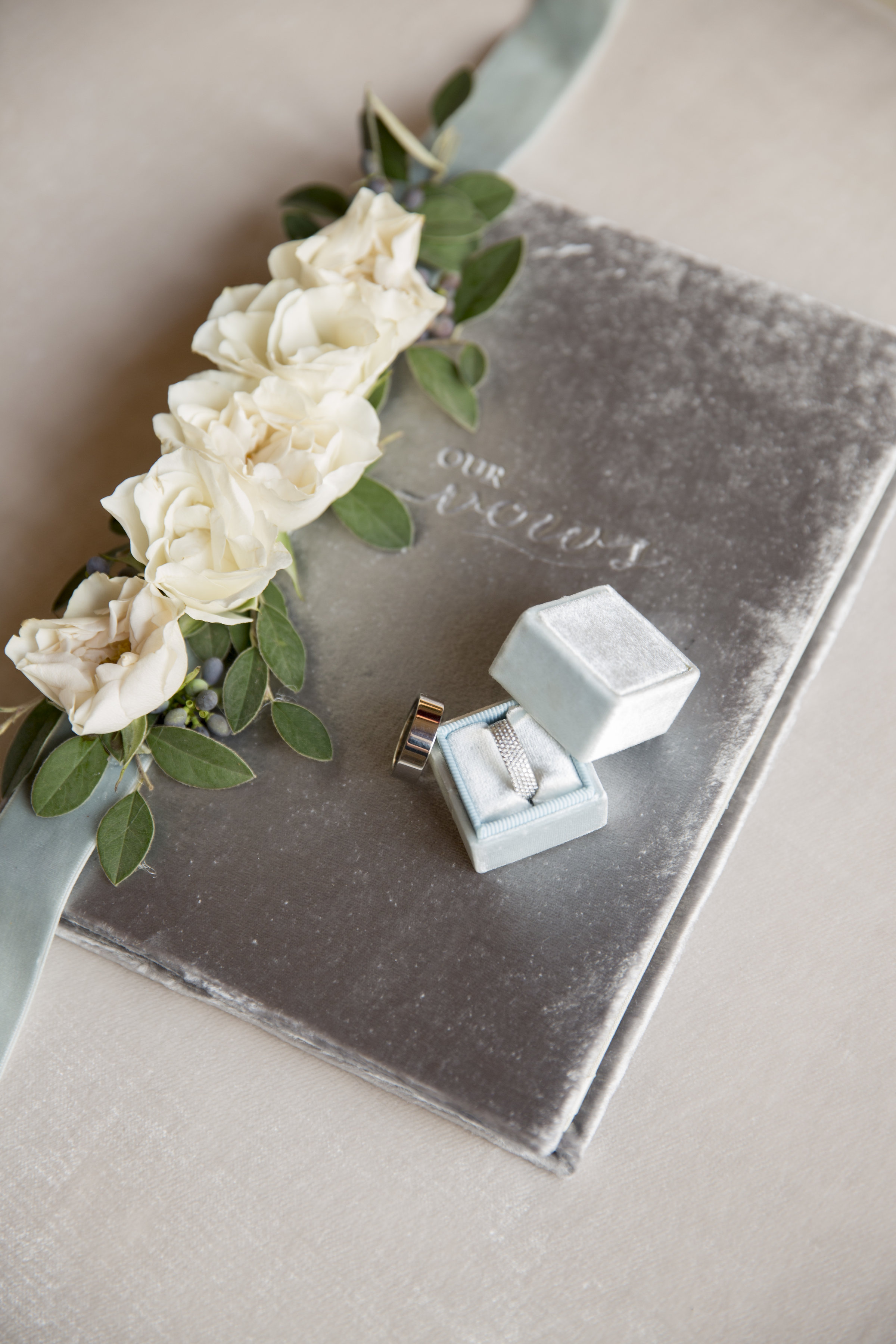 vow book and wedding rings