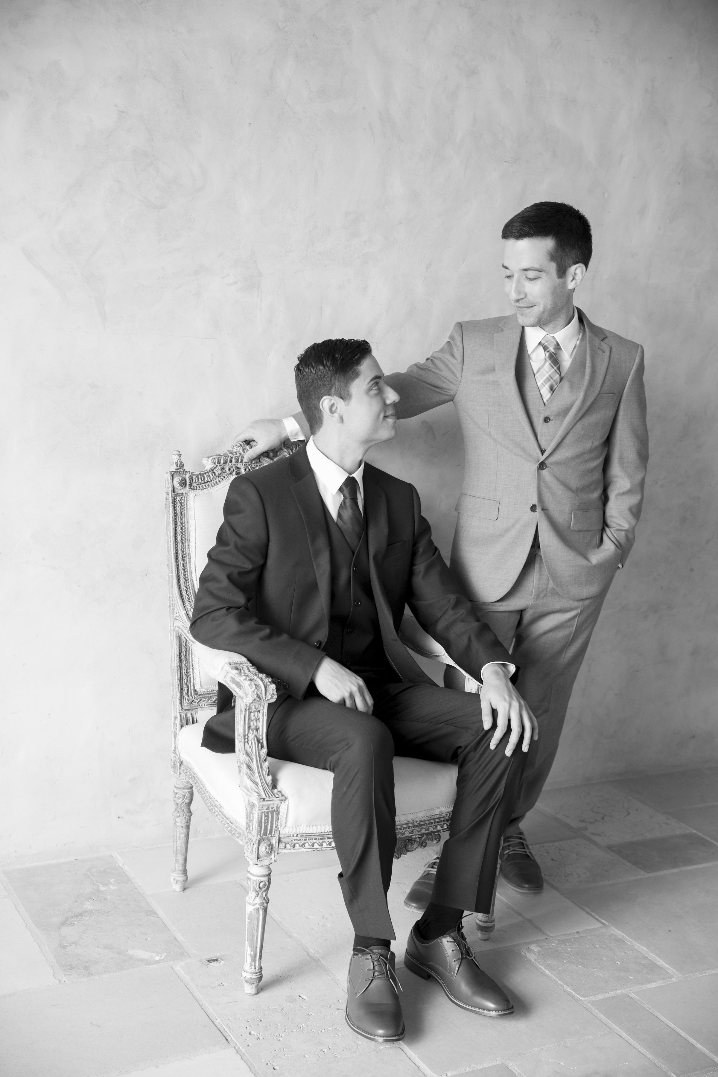 grooms in black and white