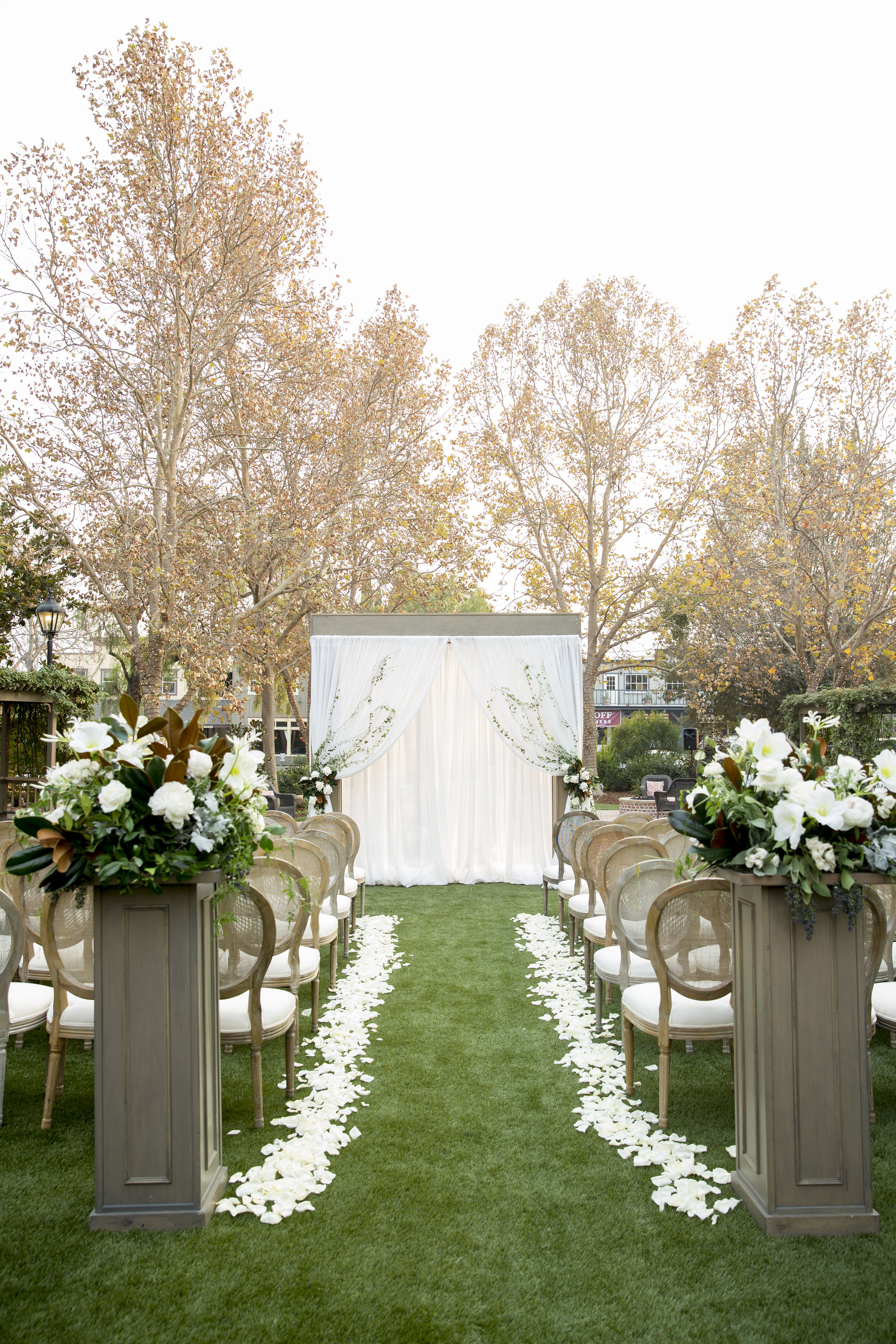 outdoor ceremony with white and green florals