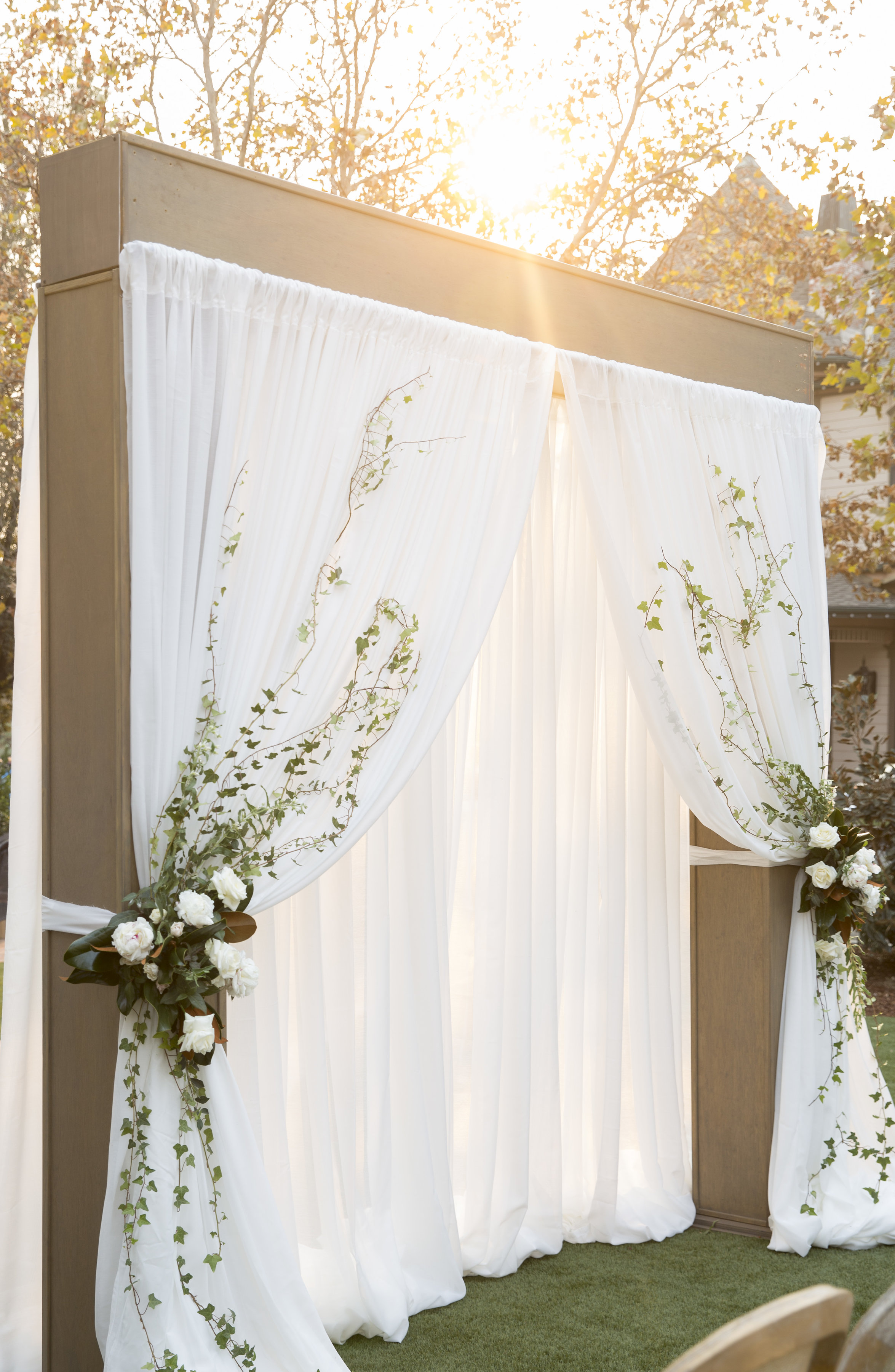 modern ceremony arch with curtains