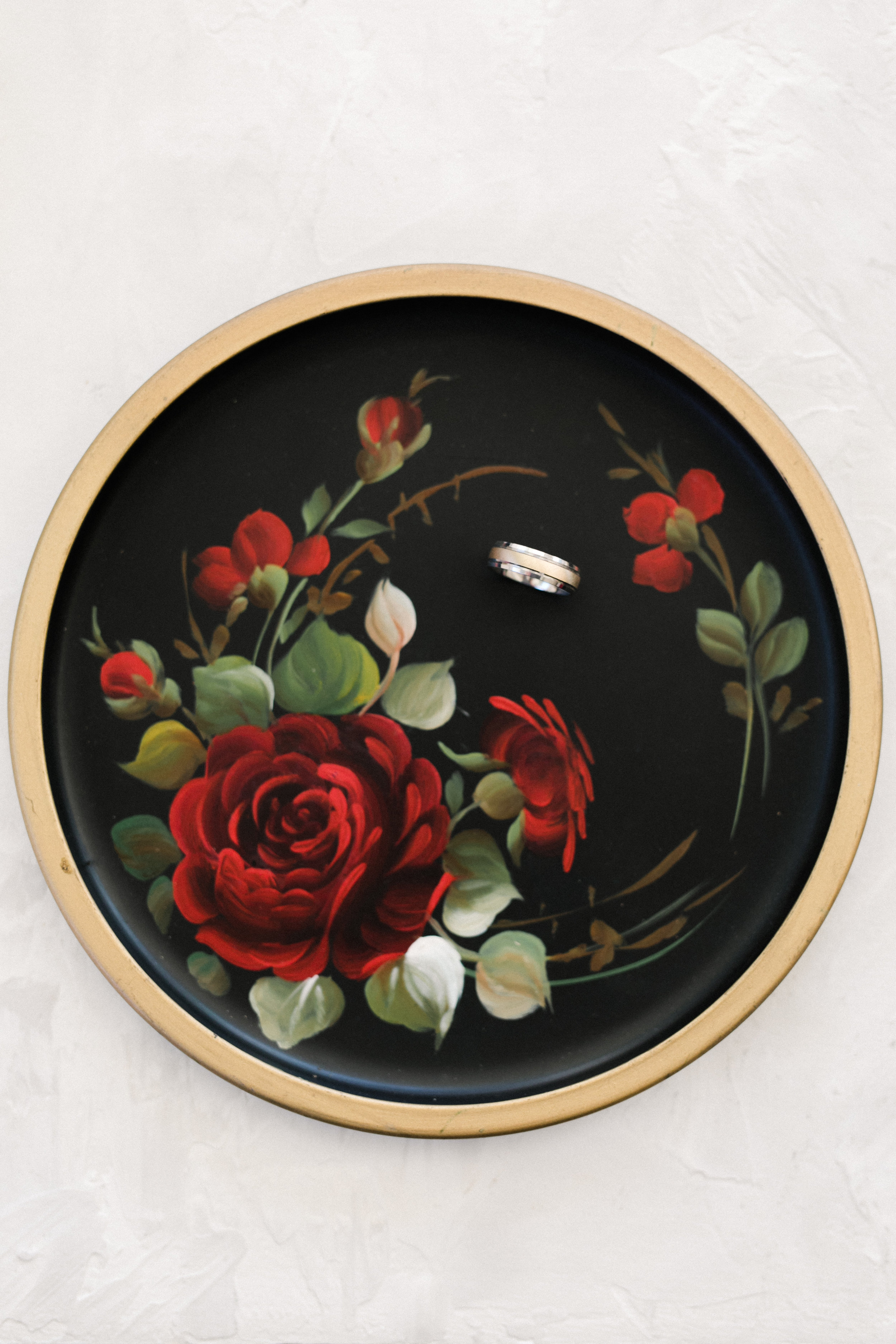 vintage floral plate with wedding ring