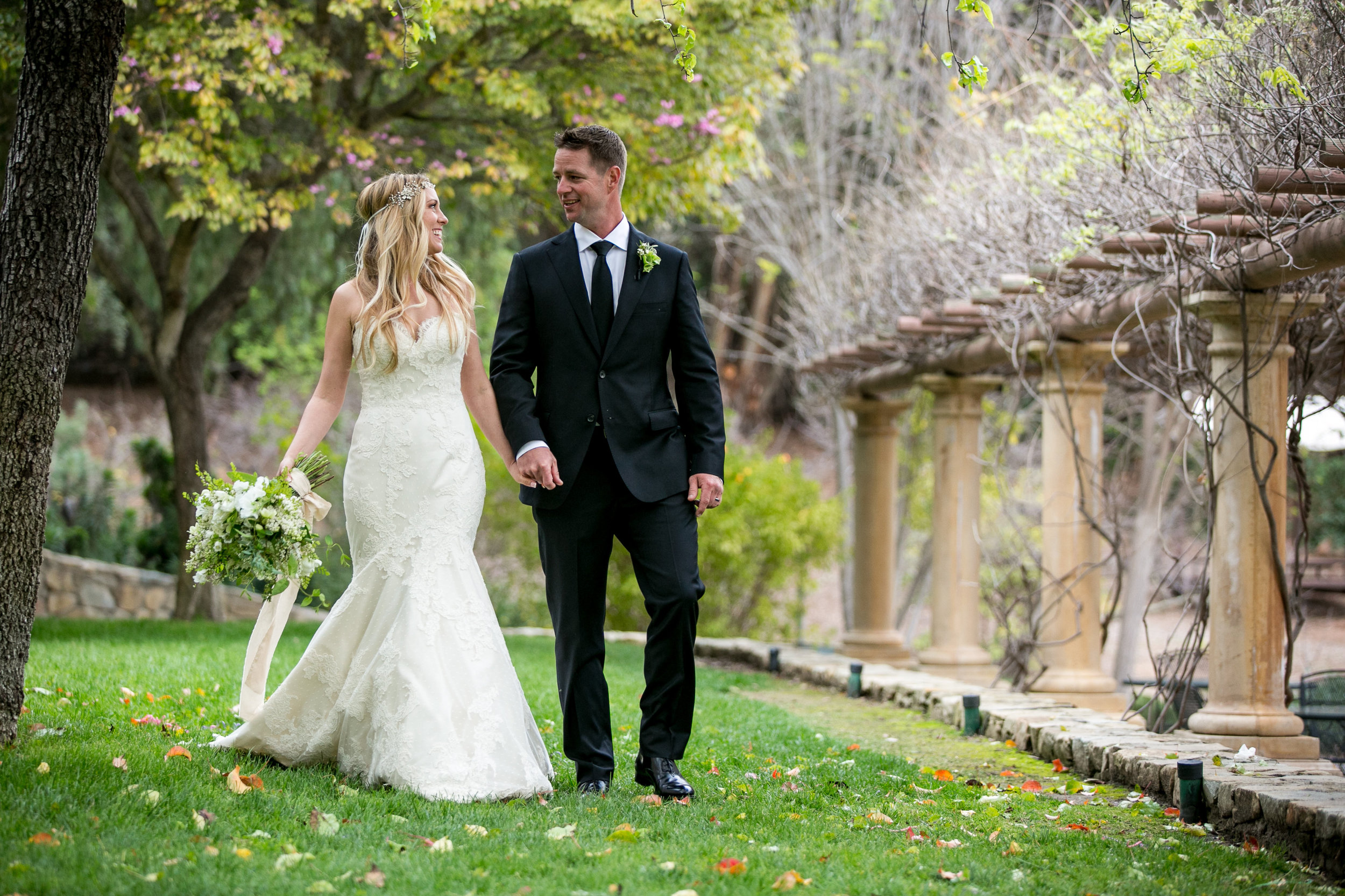 bride and groom strolling Ojai Valley Inn grounds