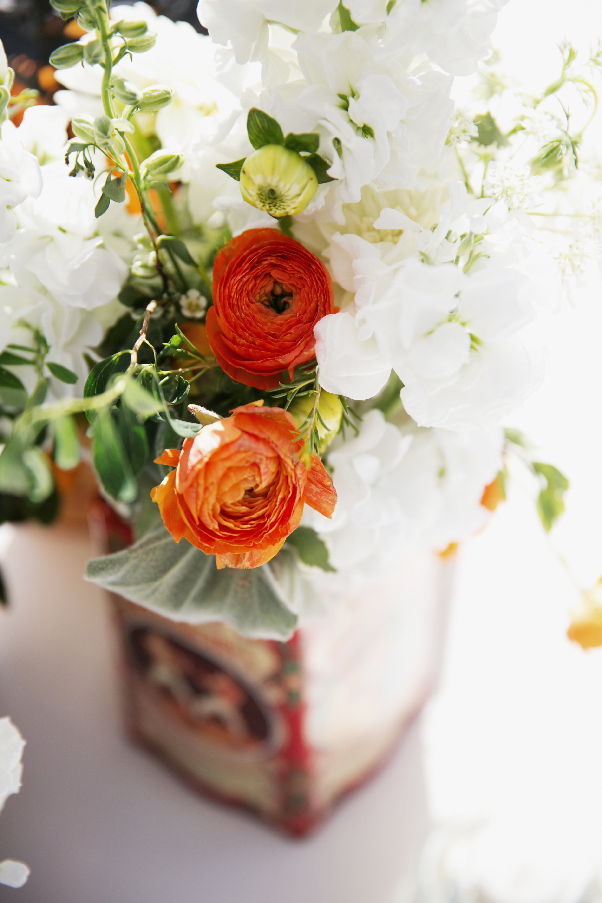 white and orange reception florals
