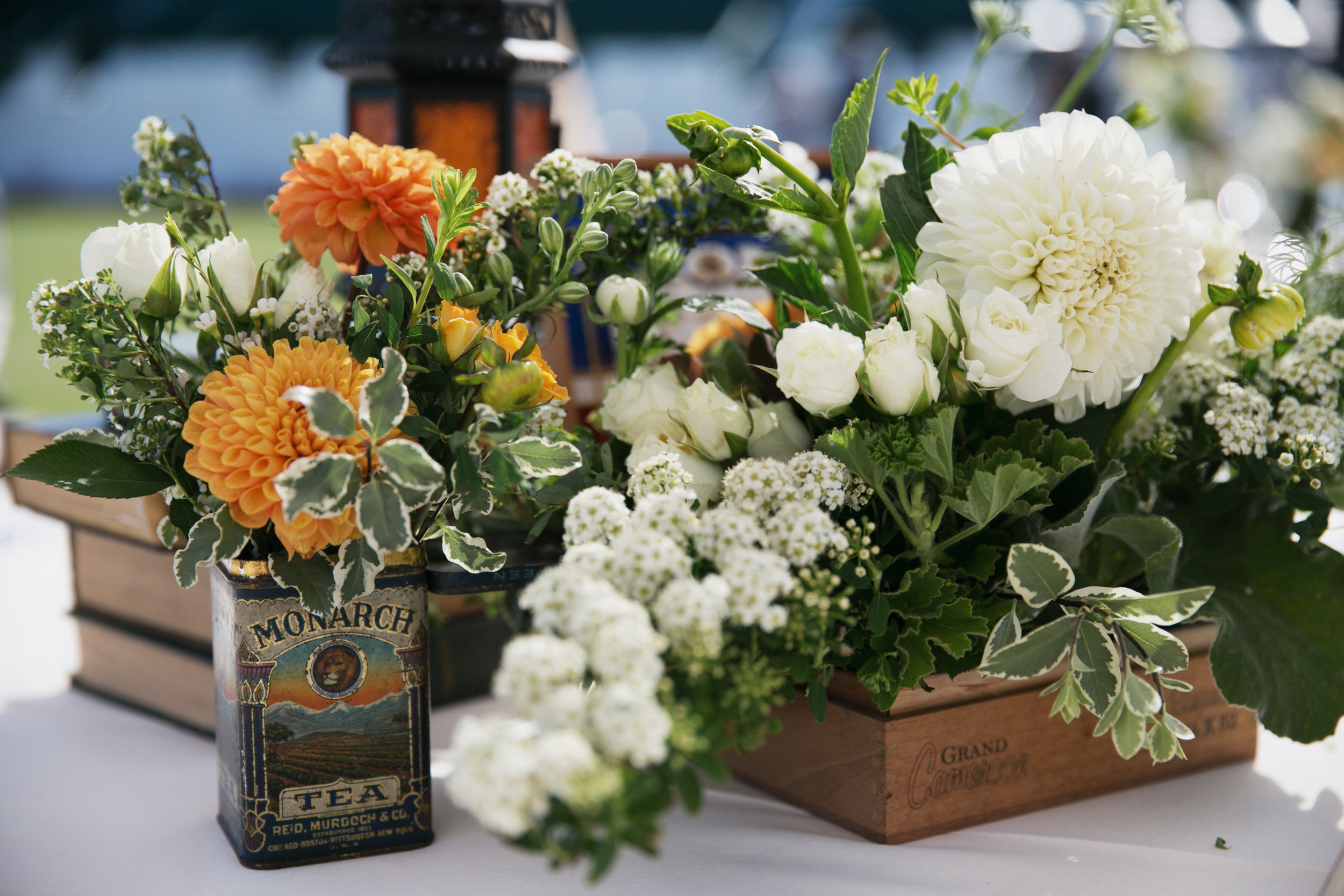 orange and white reception florals
