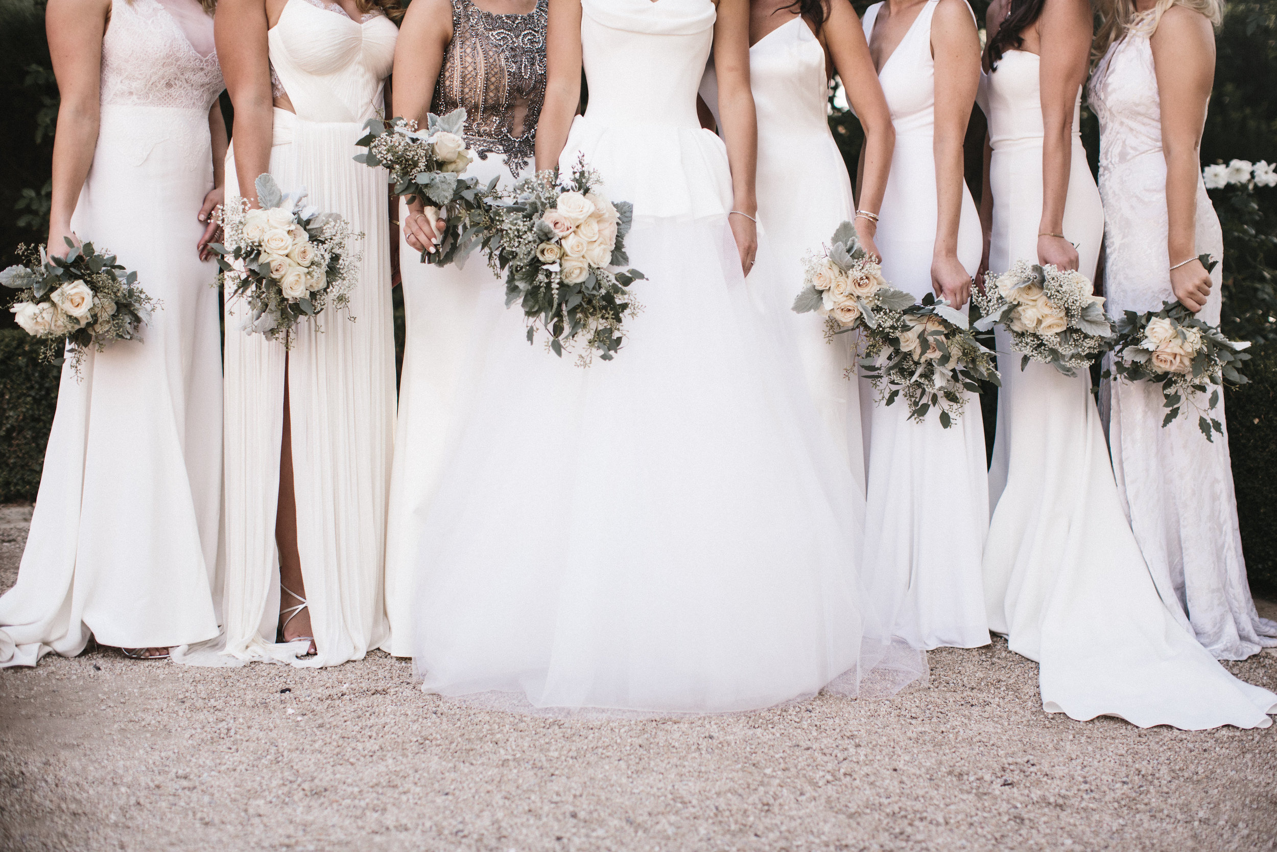 mixed style bridesmaids in white