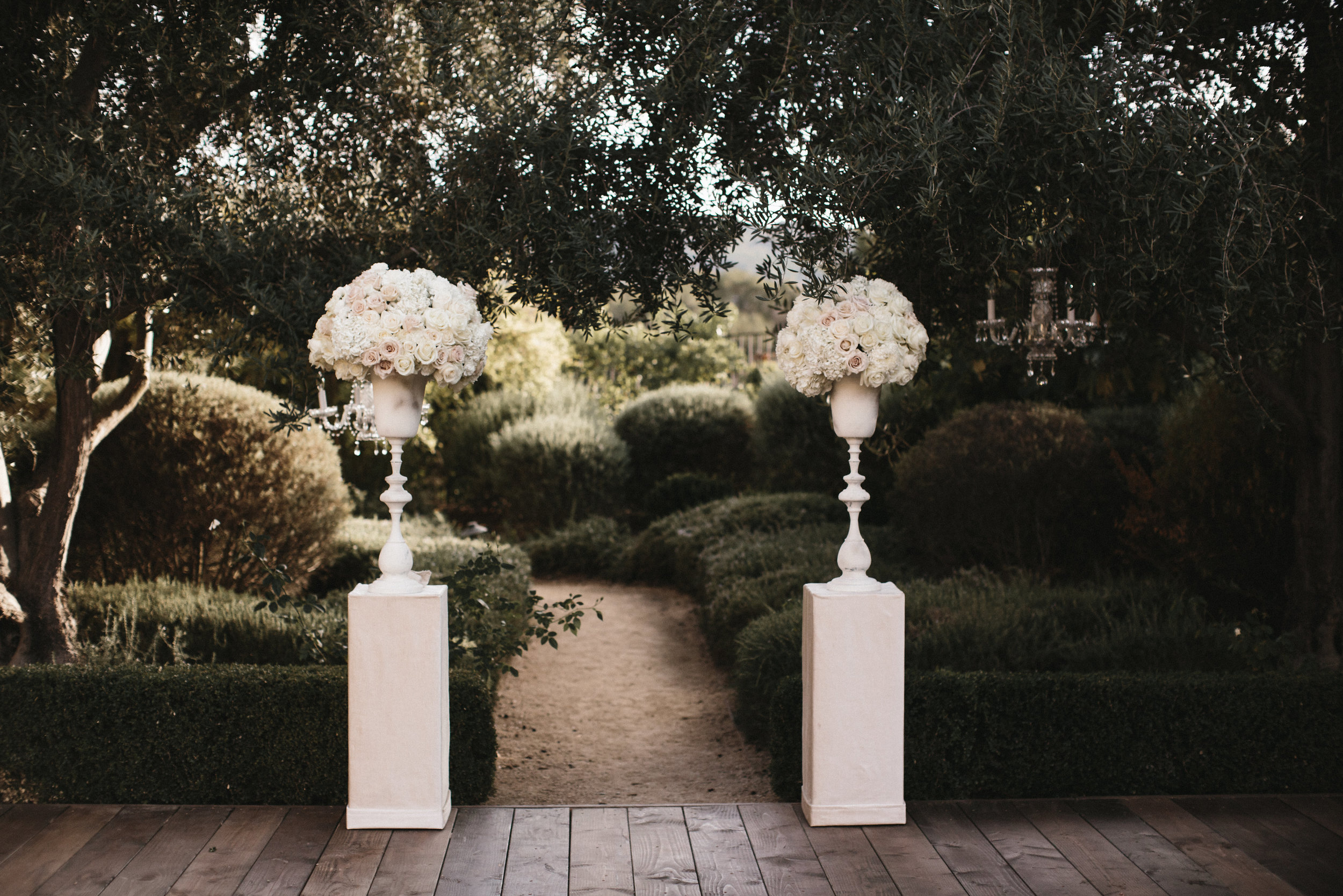 aisle floral arrangements on pedestals