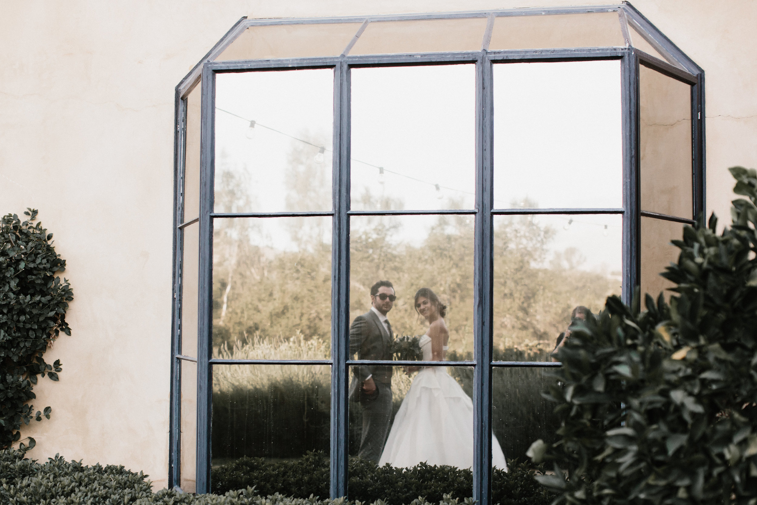 bride and groom reflection shot