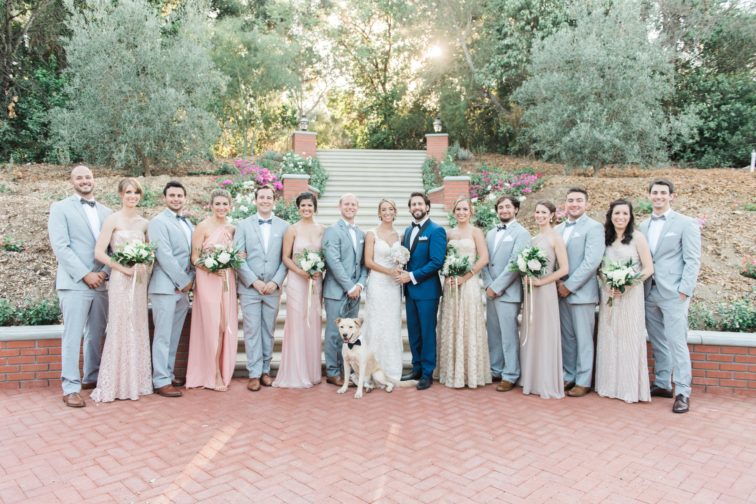 bridal party portrait in front of staircase