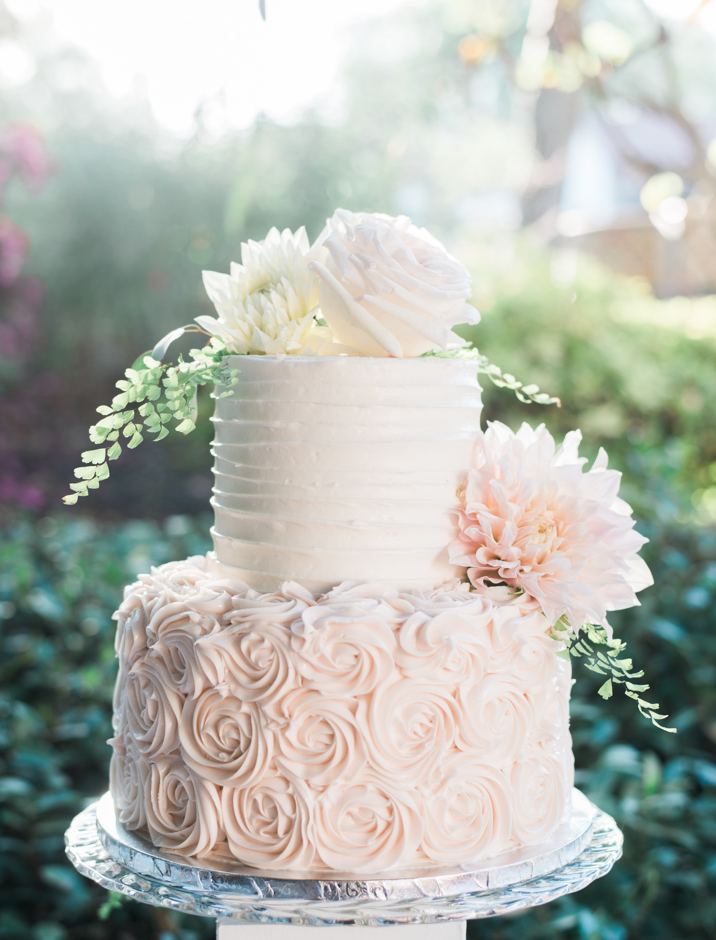 blush and white wedding cake with fresh flowers