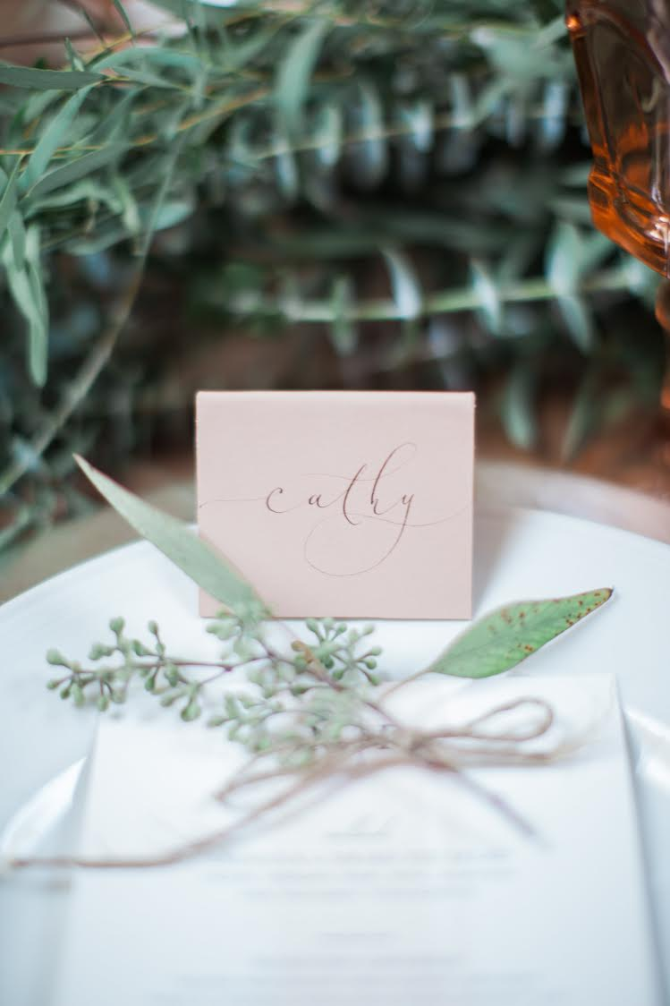 simple elegant place setting with eucalytpus sprig