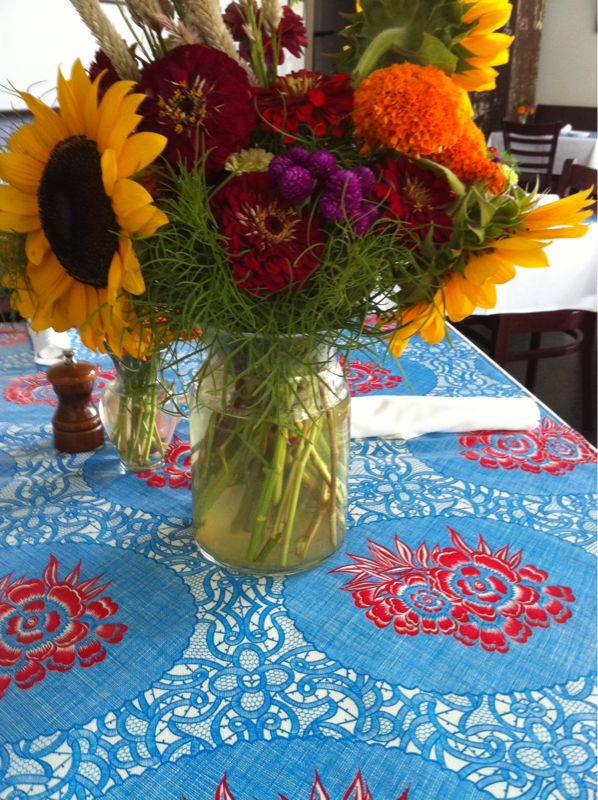 Our tables are now dressed in bright blue and red oil cloths… and beautiful local flowers by Scott & Ginni Edwards' Fertile Crescent Farm. Check them out at the Athens Farmers Market, Tuesdays at Little Kings and Saturdays at Bishop Park.