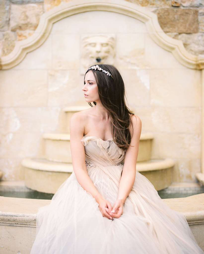 Bride in Samuelle Couture Wedding Gown Sitting on Fountain