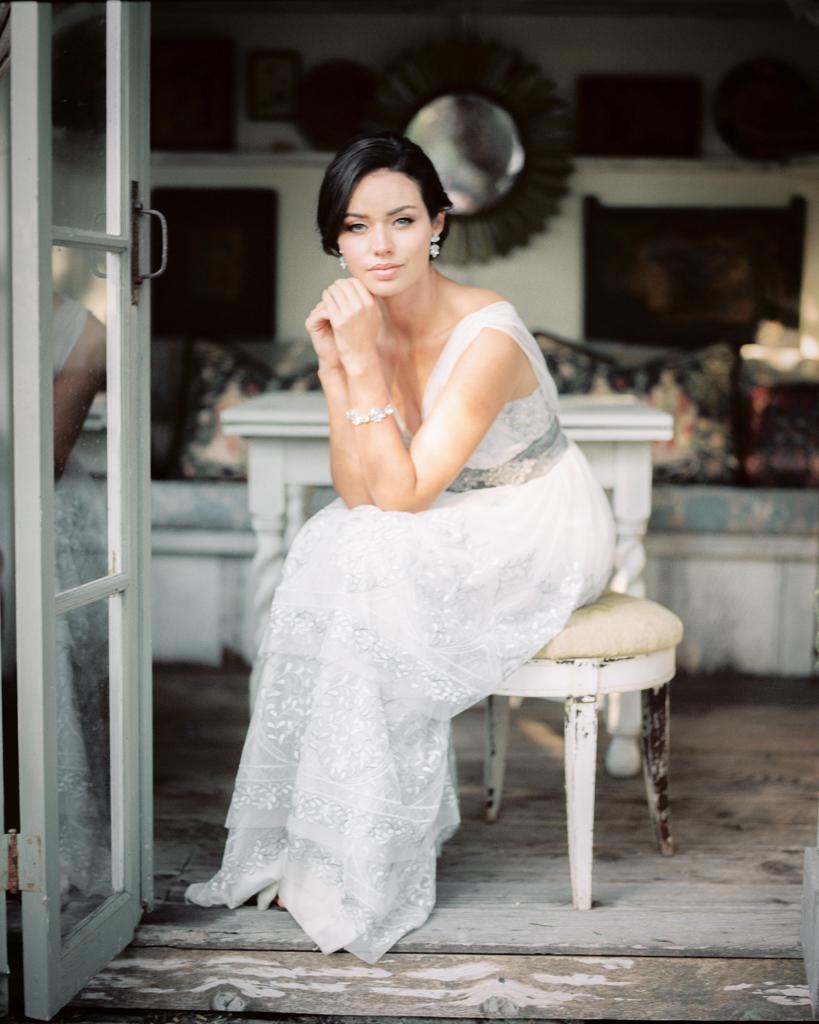 Bride Sitting At The Folley Estate Garden Wedding