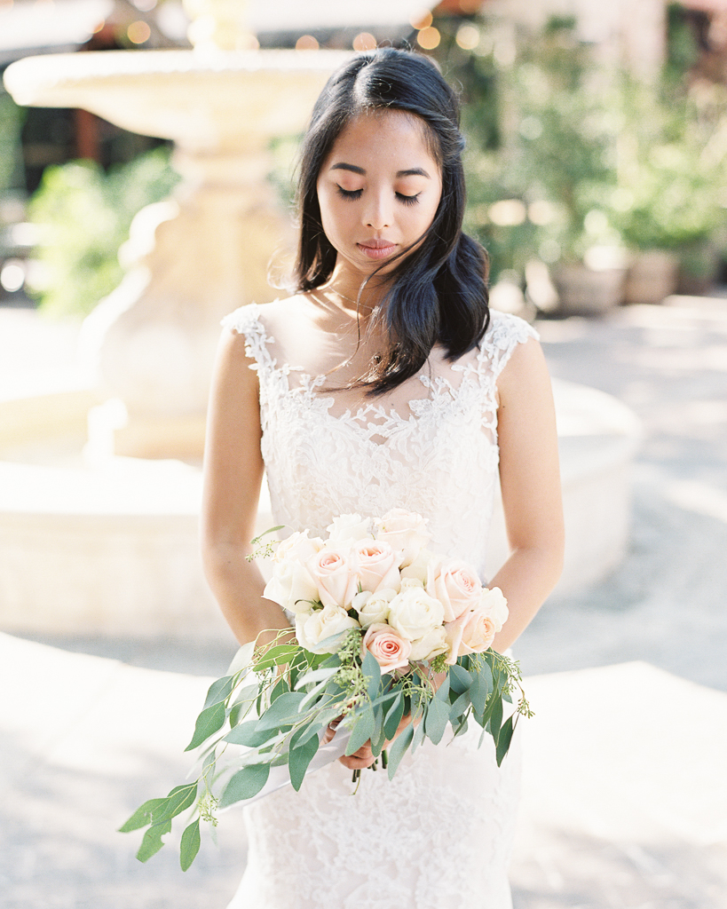 Bride Holding bouquet The Estate on Second Wedding.jpg