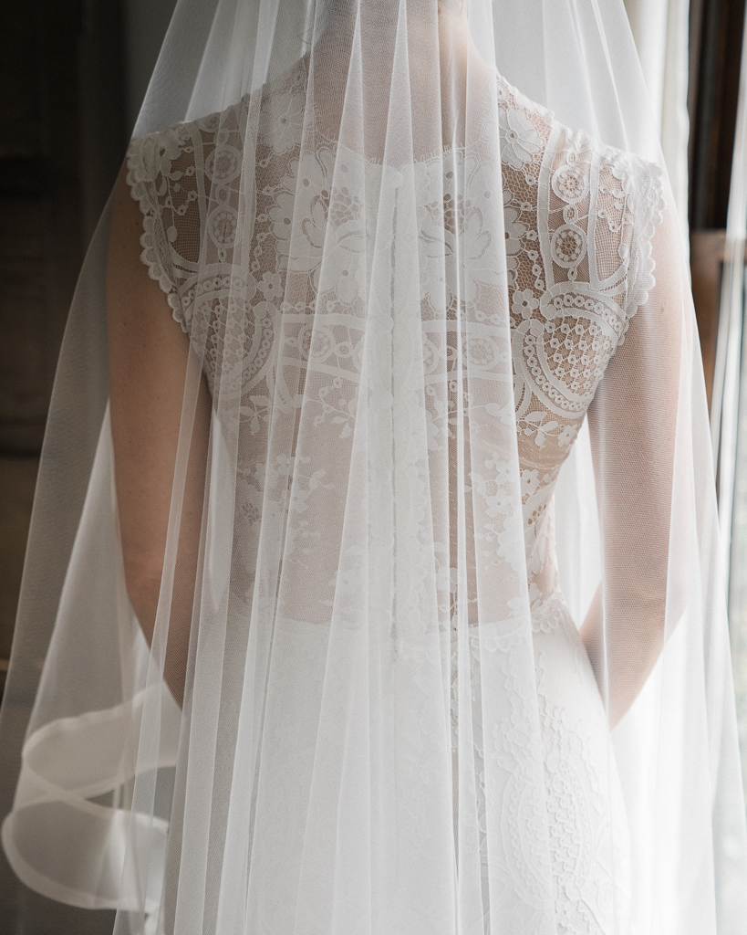 Back-Detail-of-Brides-Dress-in-Santa-Barbara-Luxe-Wedding.jpg
