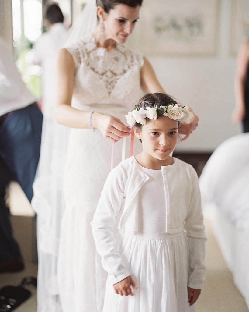 Bride-with-Flower-Girl-Putting-on-Her-Flower-Crown.jpg