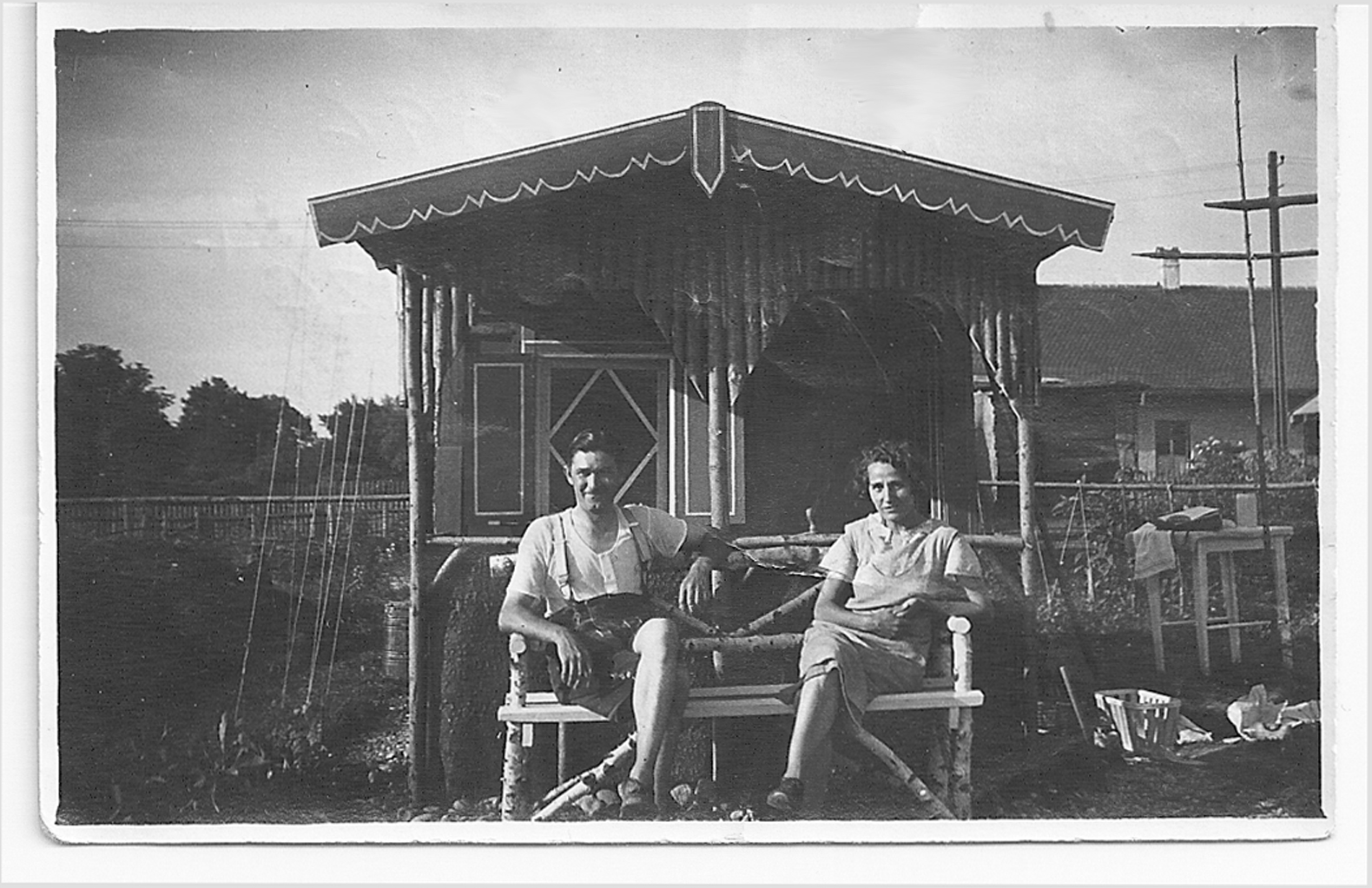Johanna's parents, pre-war, sitting in front of their garden shed, which they would use as a hiding place for Jewish friends on the run from the Gestapo.