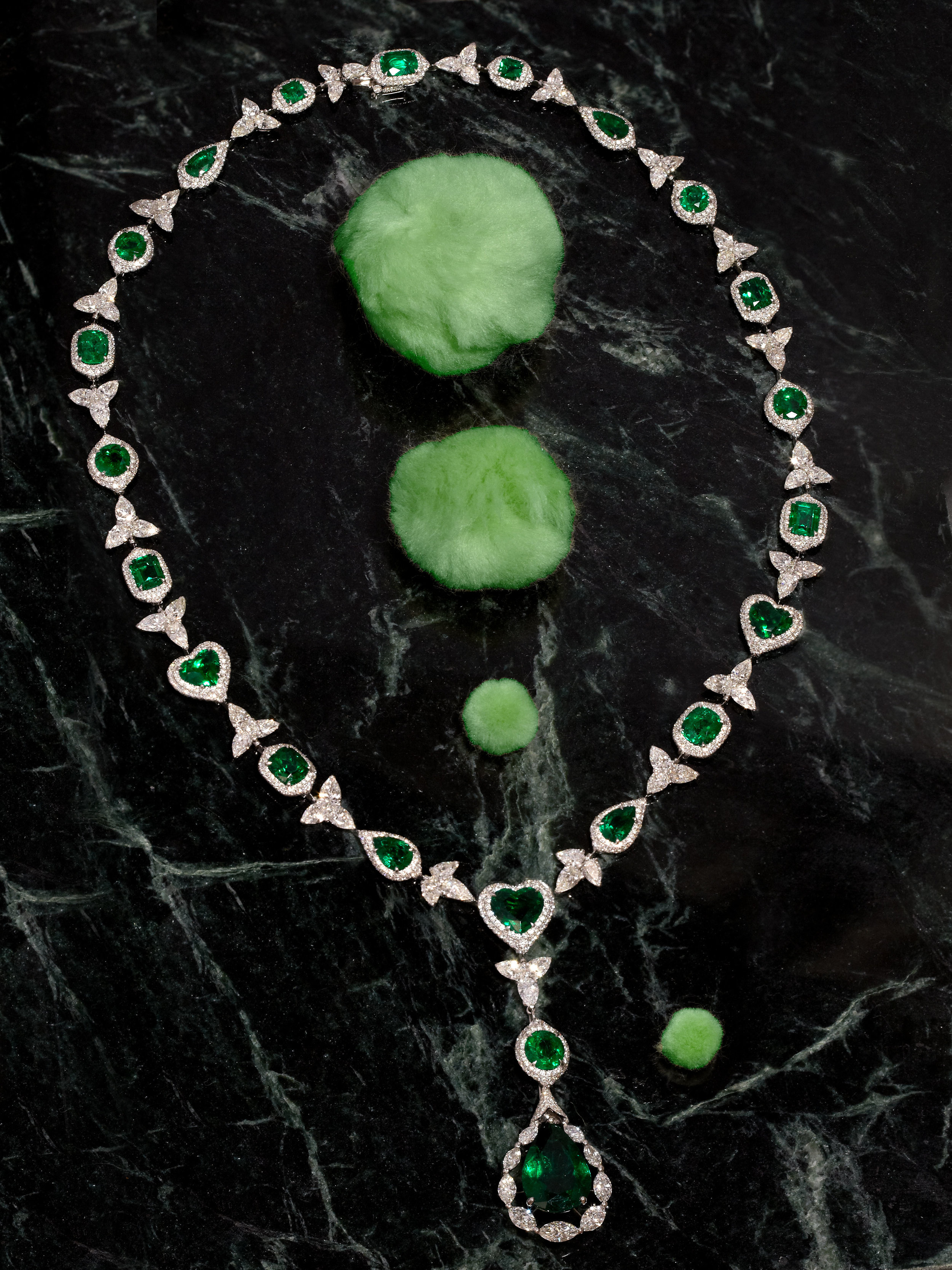 An important Colombian emerald heart shape, pear and emeraldcut necklace with an 11.23 emerald drop in 18ct white gold.