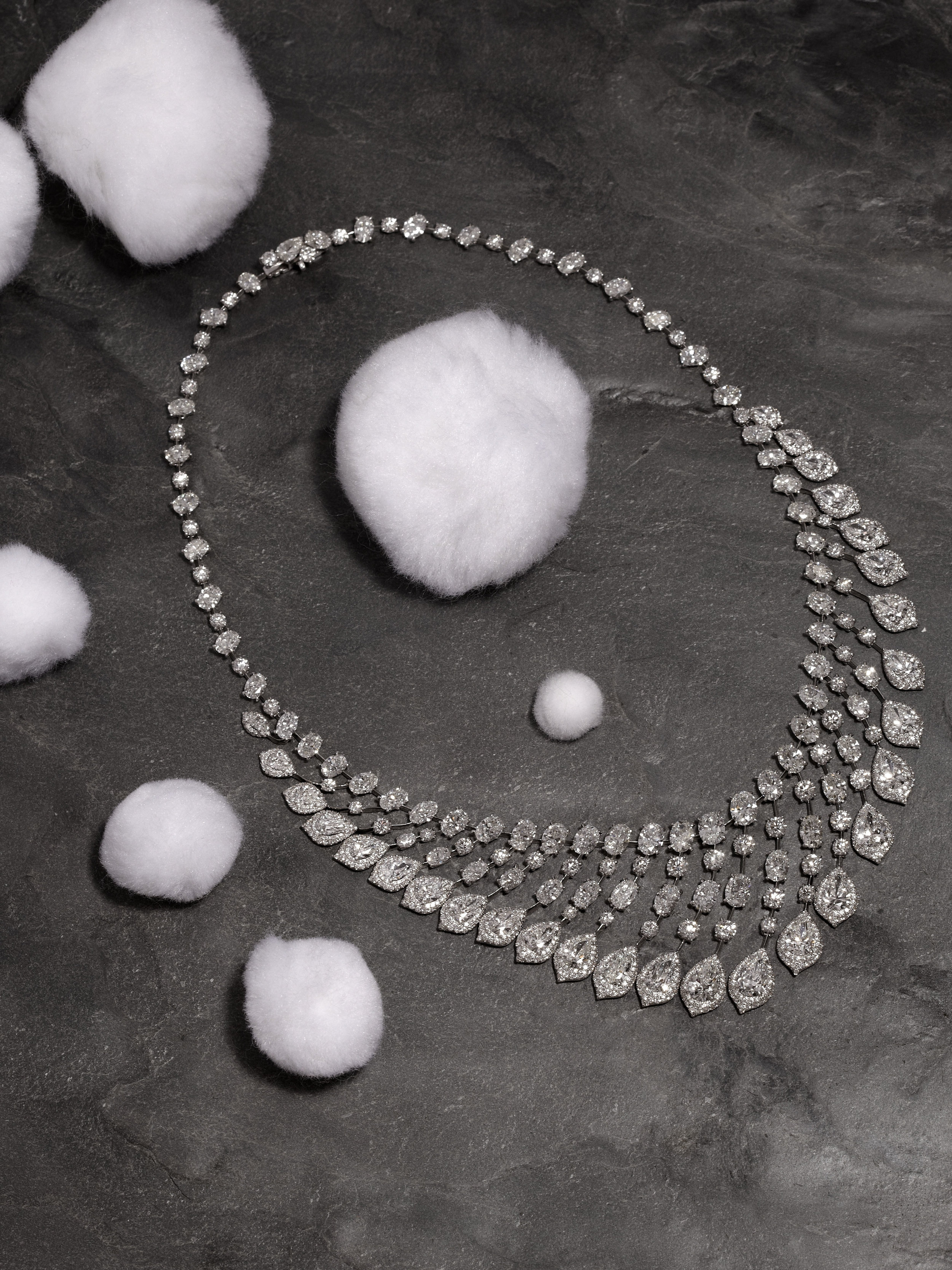 Pear shape and oval diamond wave necklace with micro-set diamond surrounds in 18ct white gold