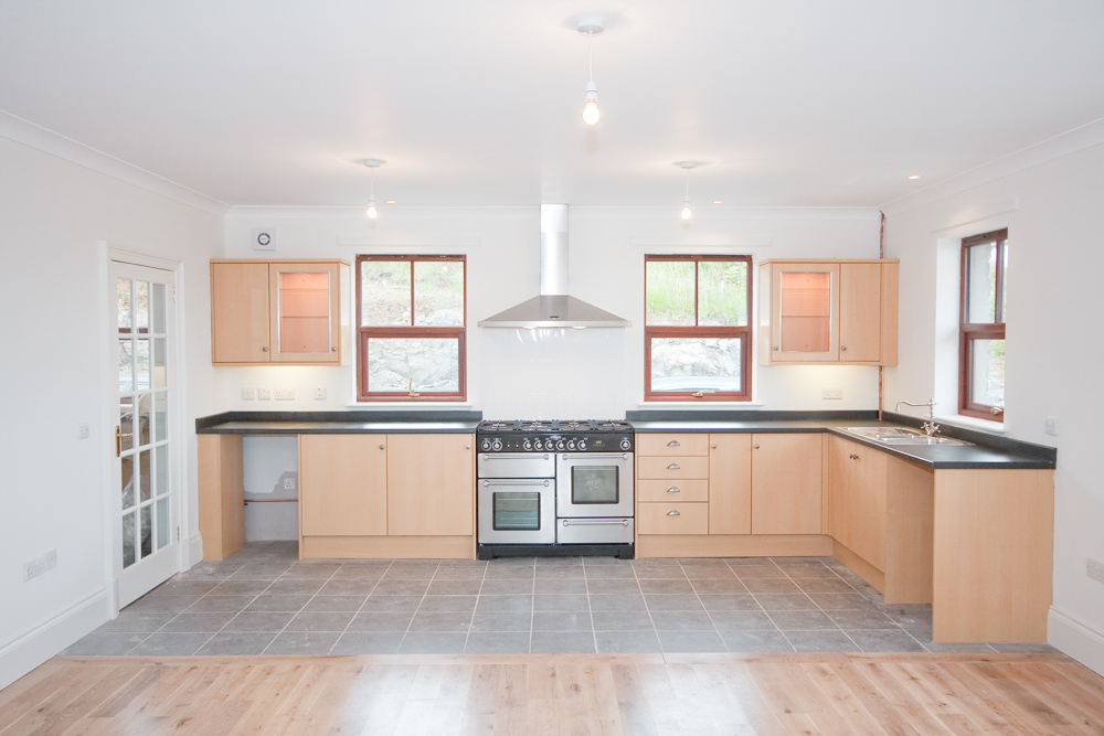 Open plan kitchen with Gas range cooker and underfloor heating.