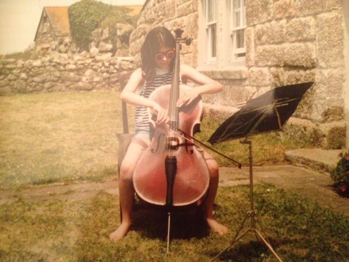 Practicing cello in the garden (Introduction to thumb position book)