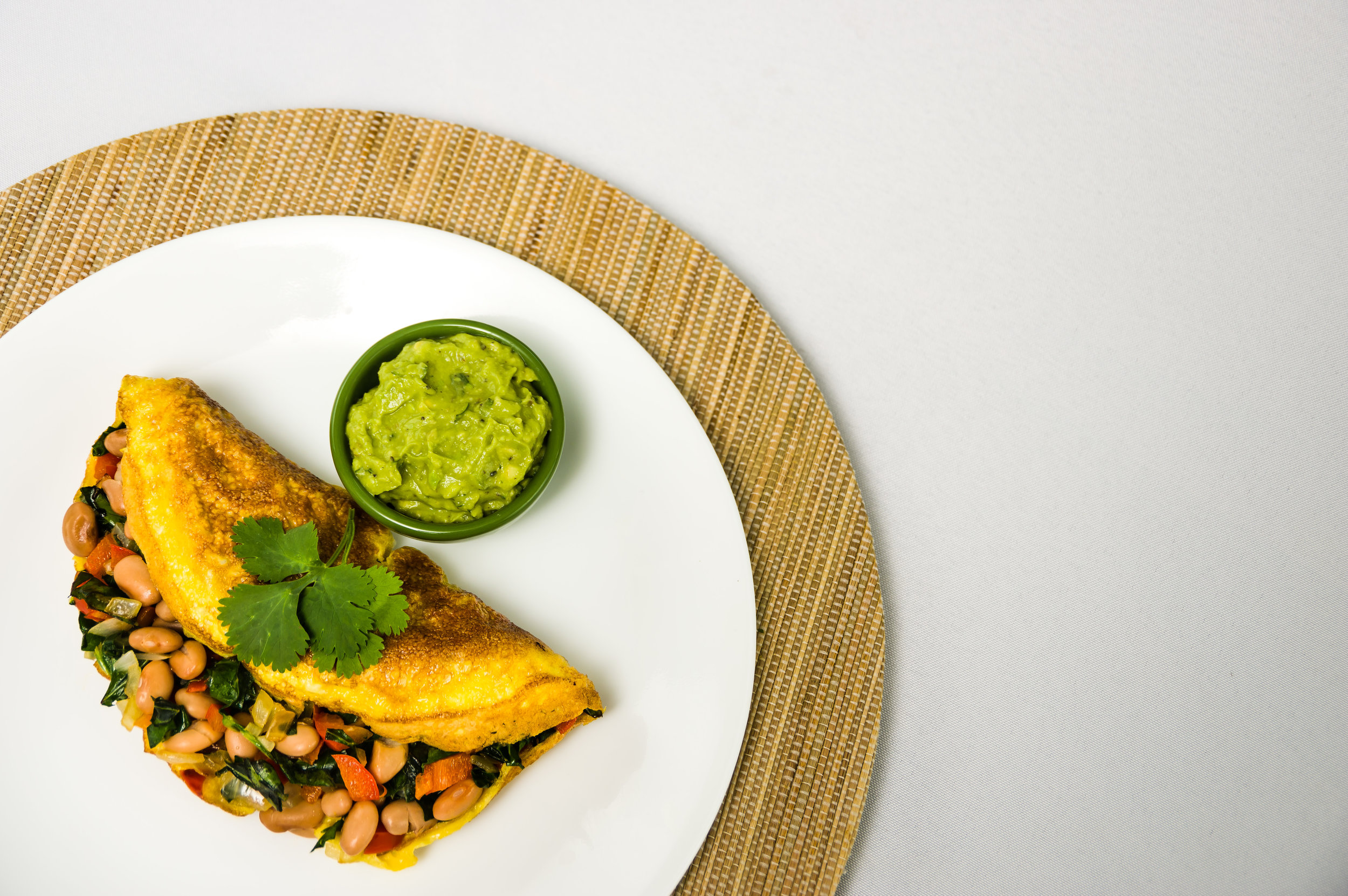Pinto Bean and Collard Omelet - A Tex-Mex omelet recipe from Cynthia Sass, RD and best-selling author, is full of that southwest flavor you crave. The best part? When you make this for breakfast or brinner ( breakfast for dinner), you are giving your body an excellent source of protein. Also, those veggies aren't in their just for their color. The nutrients found between those veggies will add a healthy portion to your daily needs, and give your body the tools it needs to support itself.