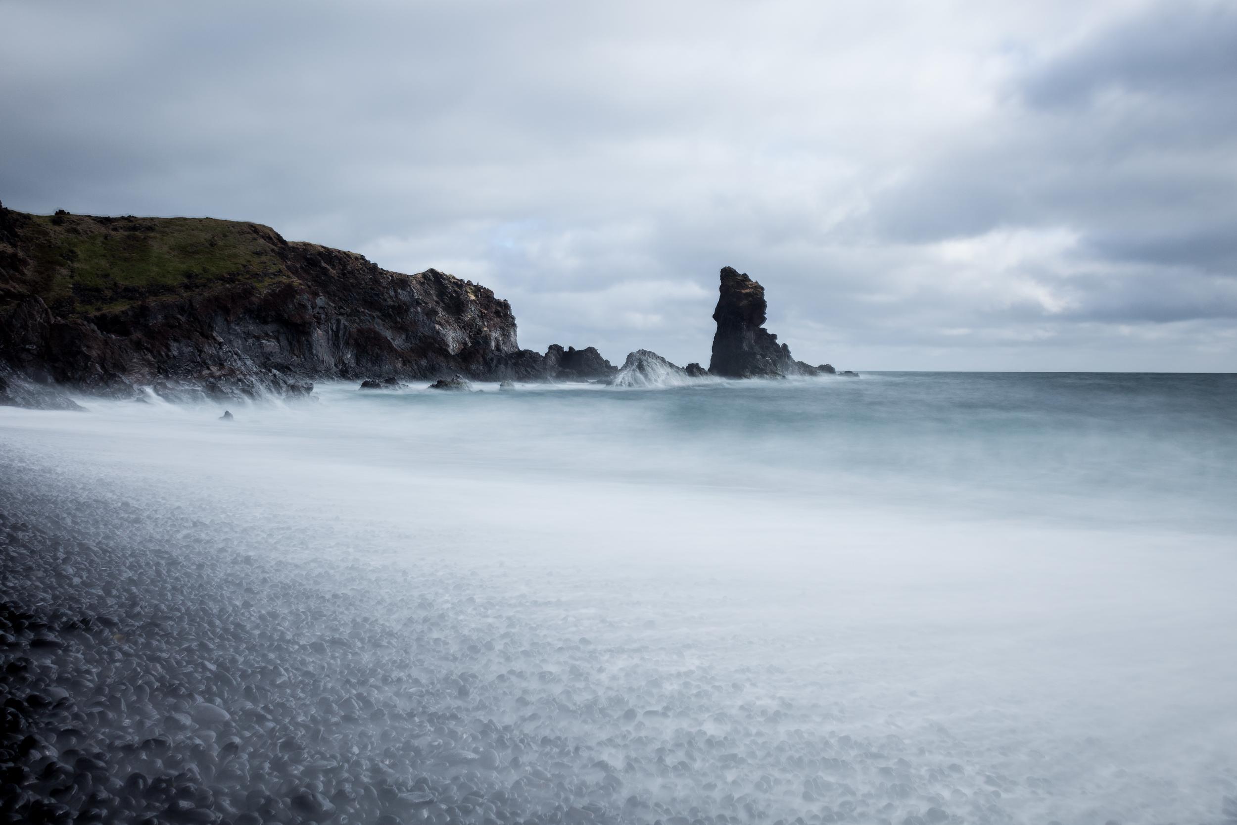 Gossamer waves washing over the pebbles