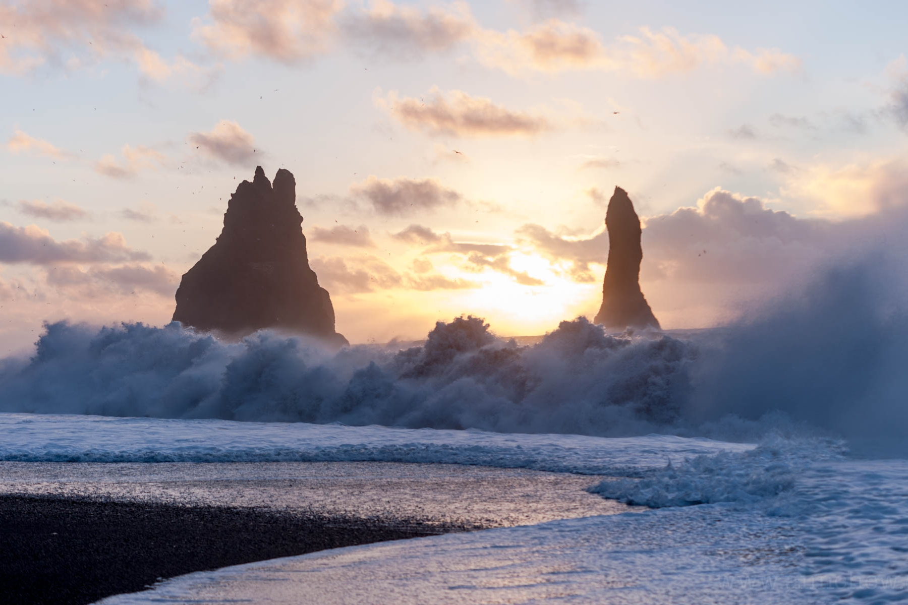 """In spite of the giant sign warning of these unpredictable, strong """"sneaker waves"""" in multiple languages, tourists drown every year at the famous Reynisfjara black sand beach ..."""