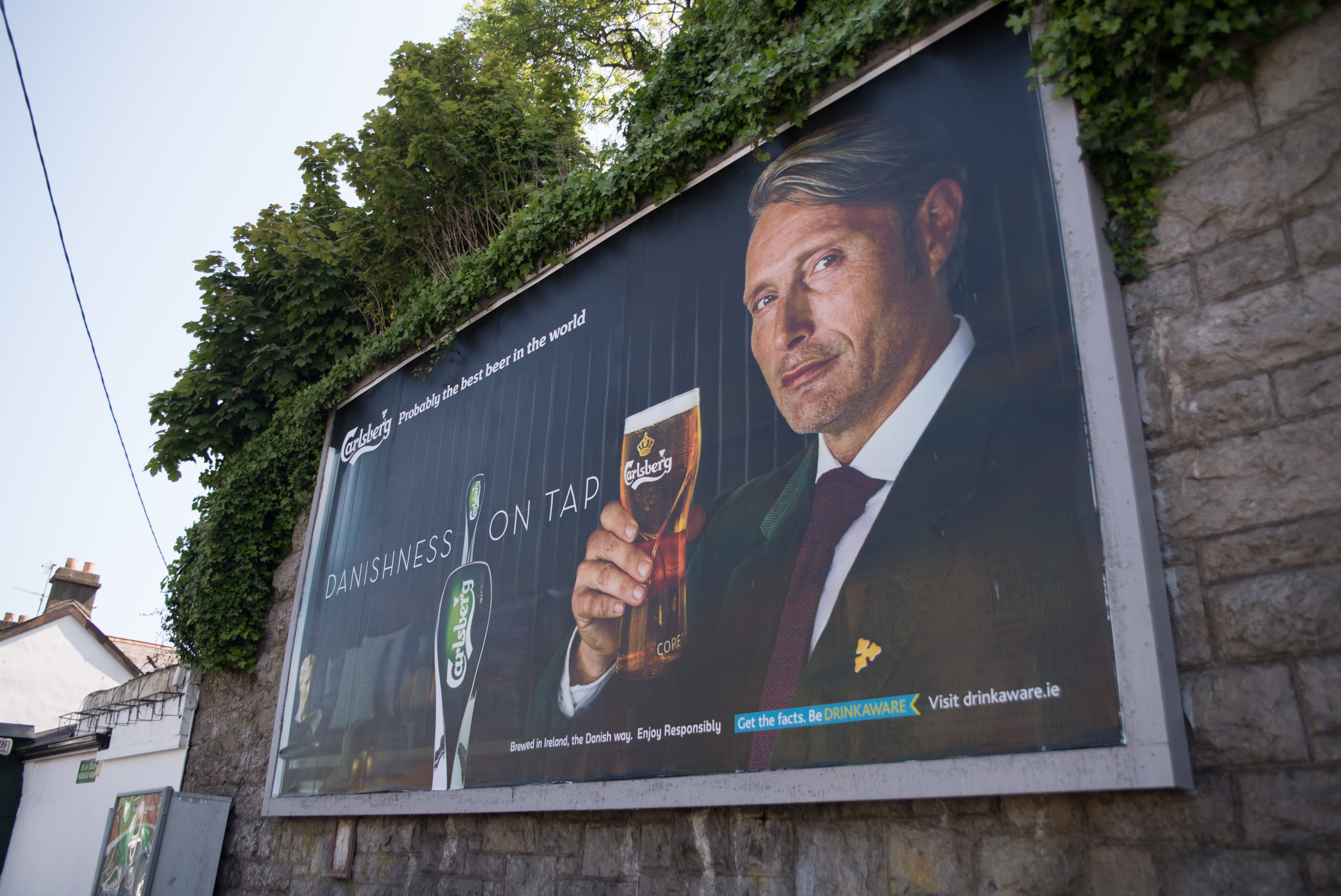 Mads Mikkelsen's face is on so many billboards for this beer (which by the way is very good).