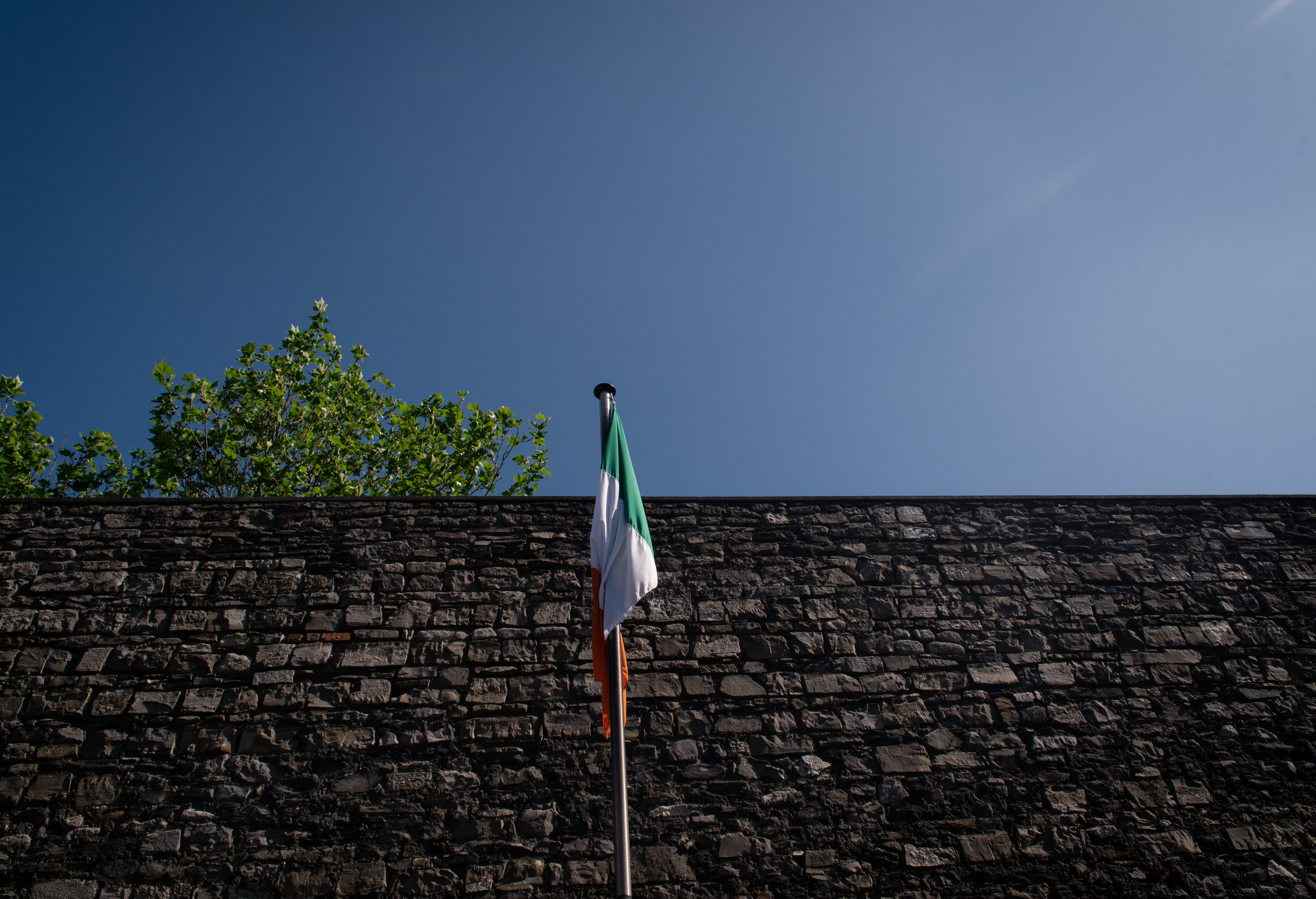 The Irish Tricolor stands in the middle of the courtyard.