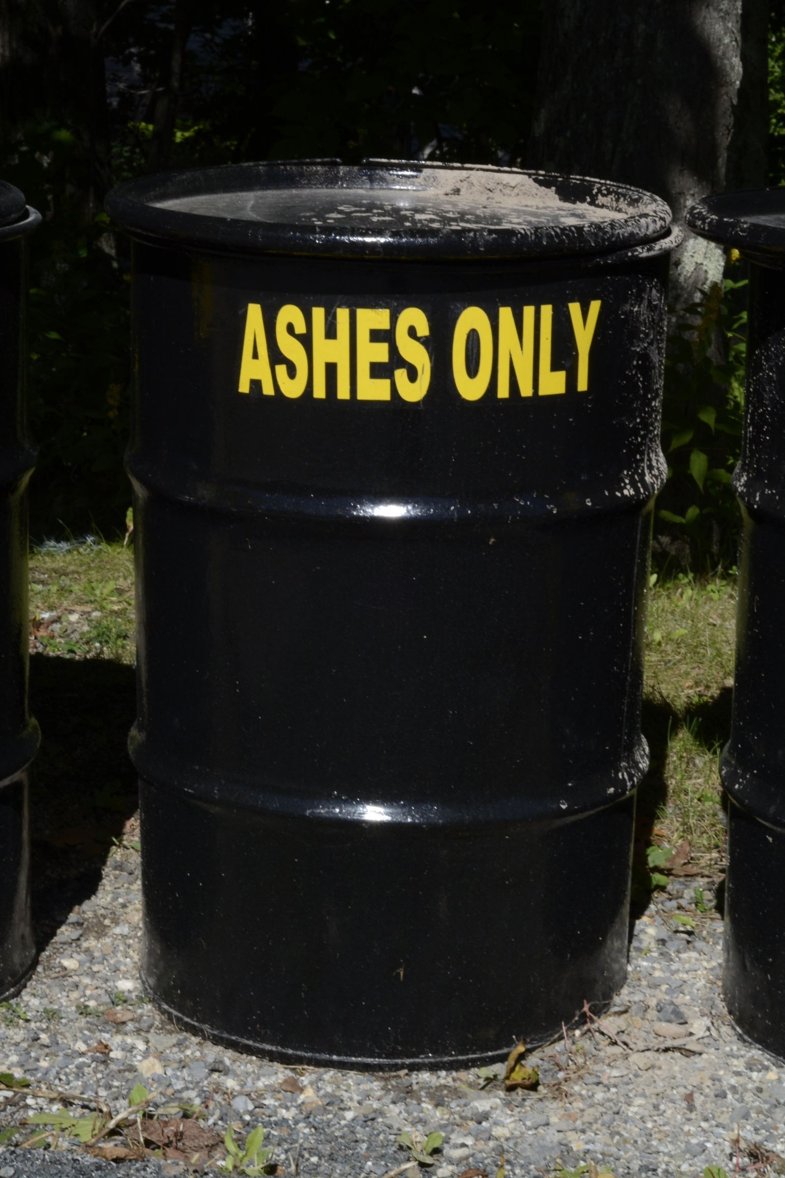 """Even """"cold"""" ashes from fireplaces should be place in the black ash barrels provided at the two trash compactors on the mountain. Coals covered in ash can remain dangerously hot for days."""