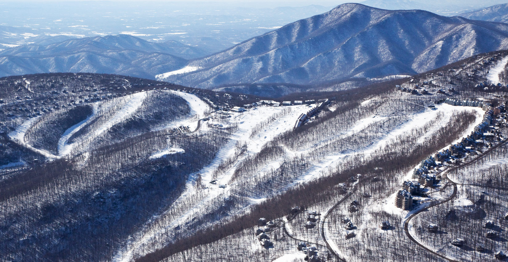 Wintergreen Resort's slopes    offer something  for both black diamond fans and tiny tots. The snowboarding park is served by a six-seat high-speed lift. There is  ice skating . The new, multi-million-gallon  snowmaking  system ensures the grins keep coming.  Check it out .