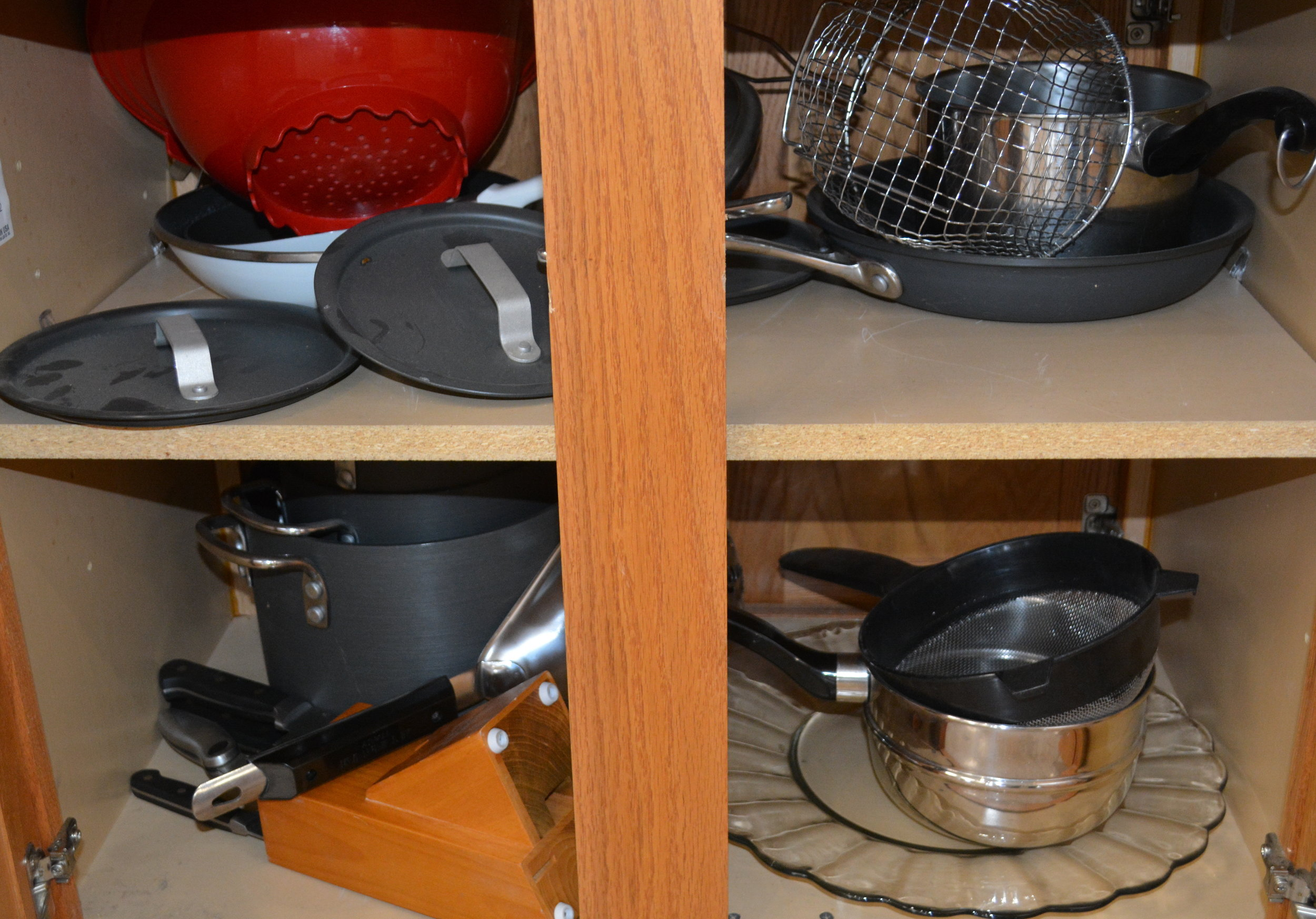 The kitchen carries a selection of pots and pans.