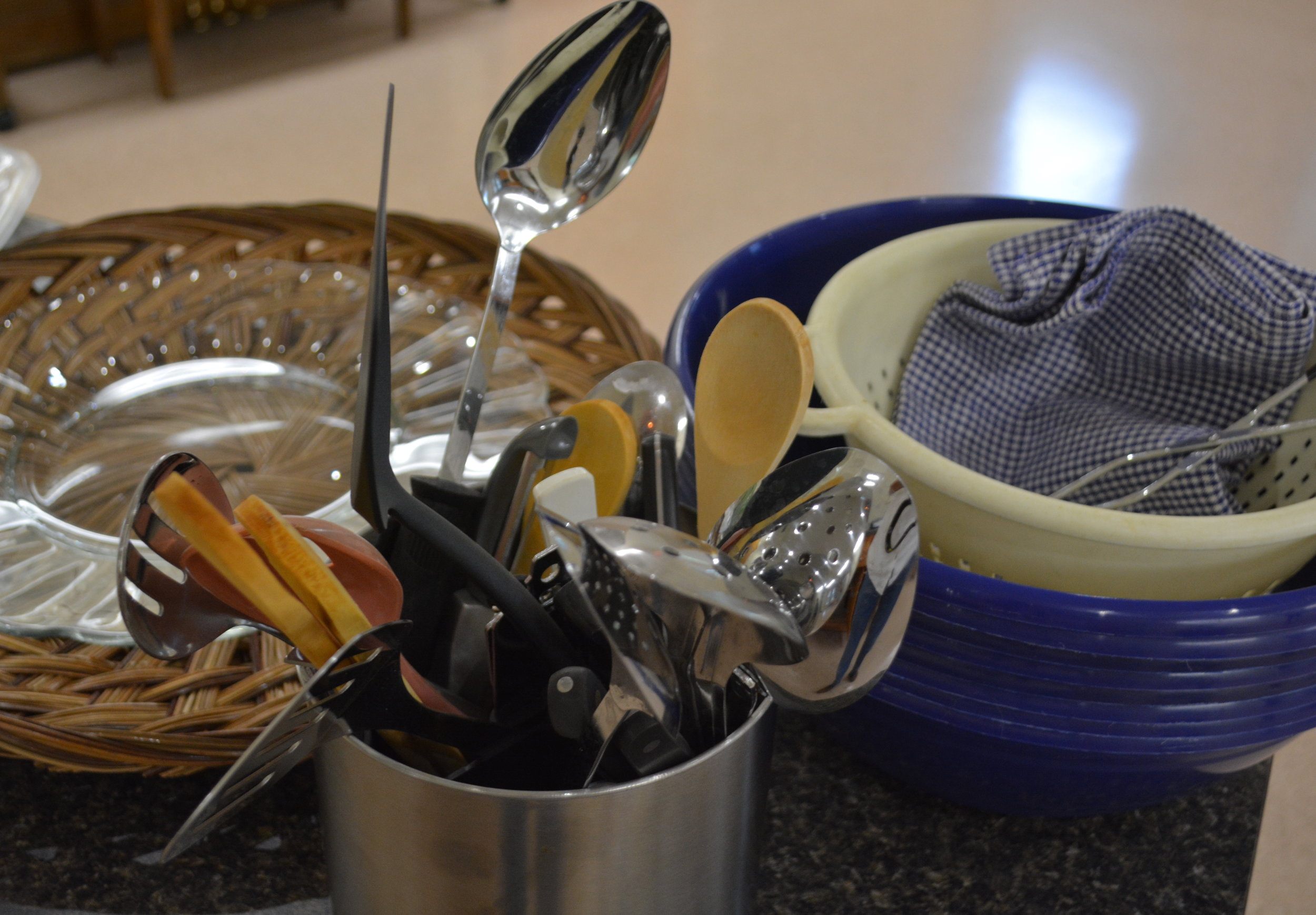 There are serving utensils, large plastic bows for chips, and trays.