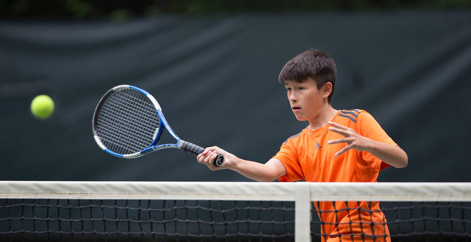 tennis-kid-at-net.jpg