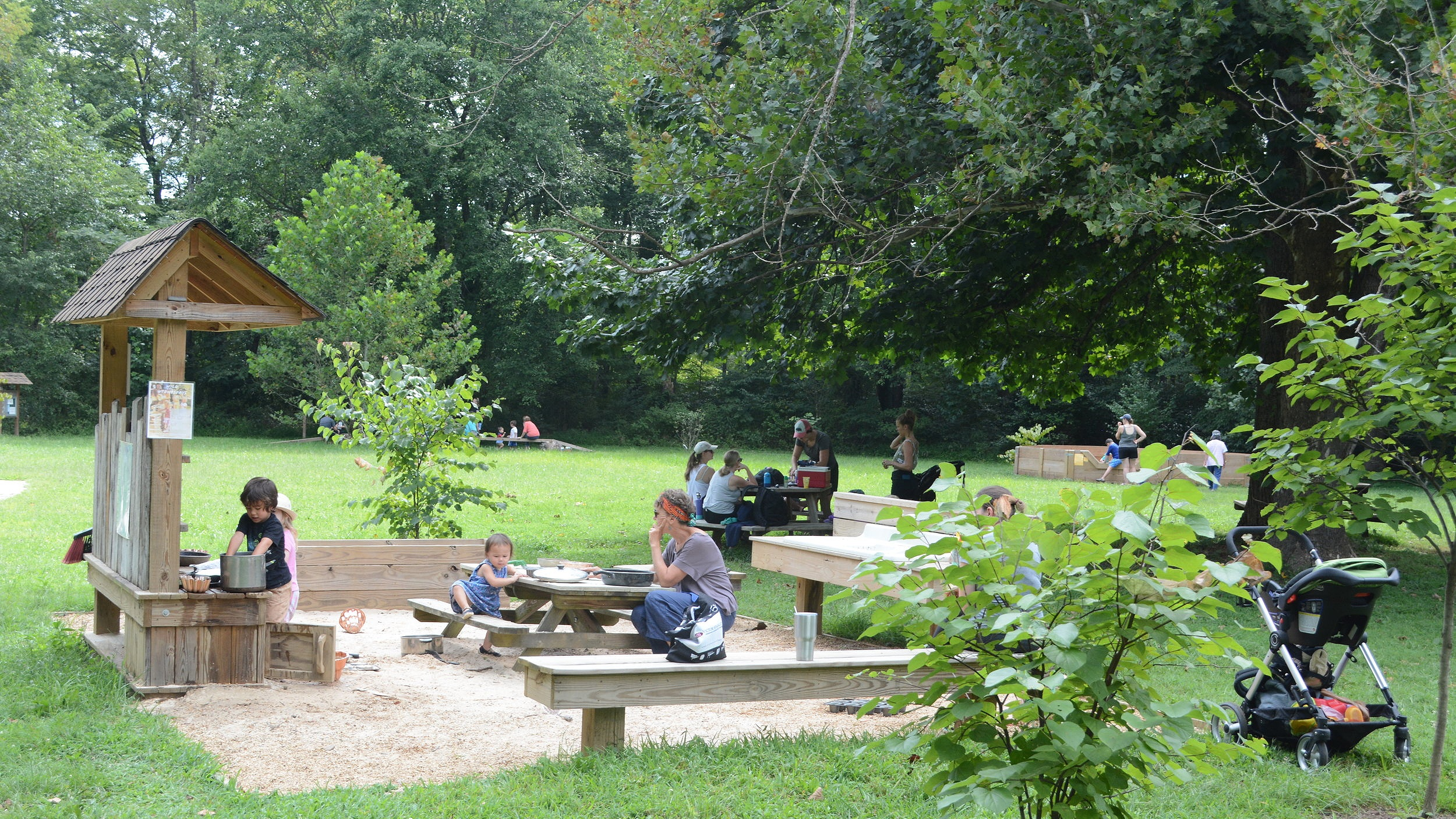 The mud kitchen was thoughtfully put near picnic tables under a shade tree.
