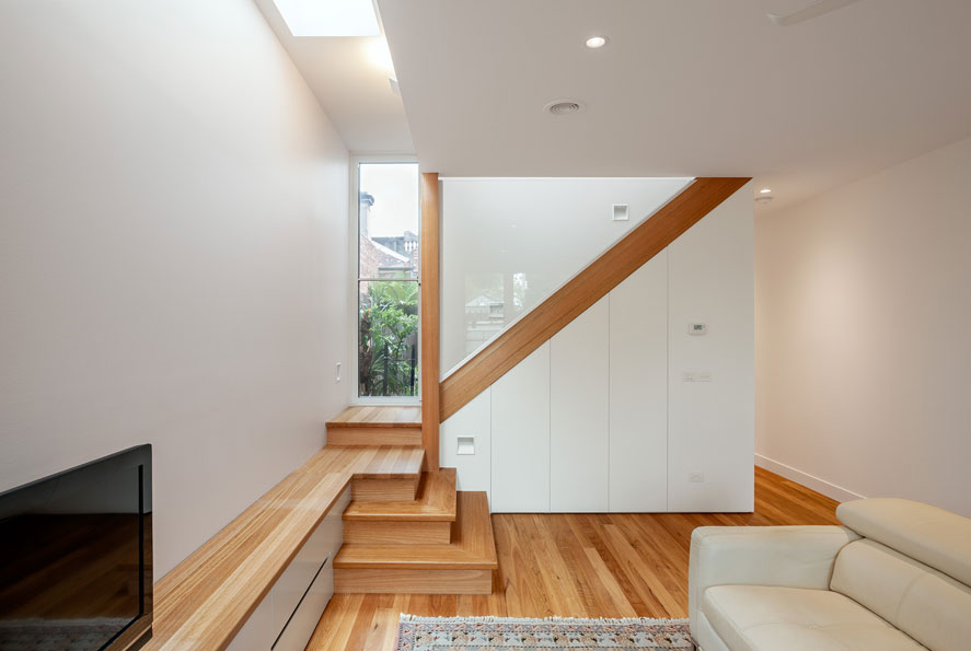 naturally lit living skylights garden views cross ventilation timber cabinetry staircase bespoke design timber floor green sheep collective architect black